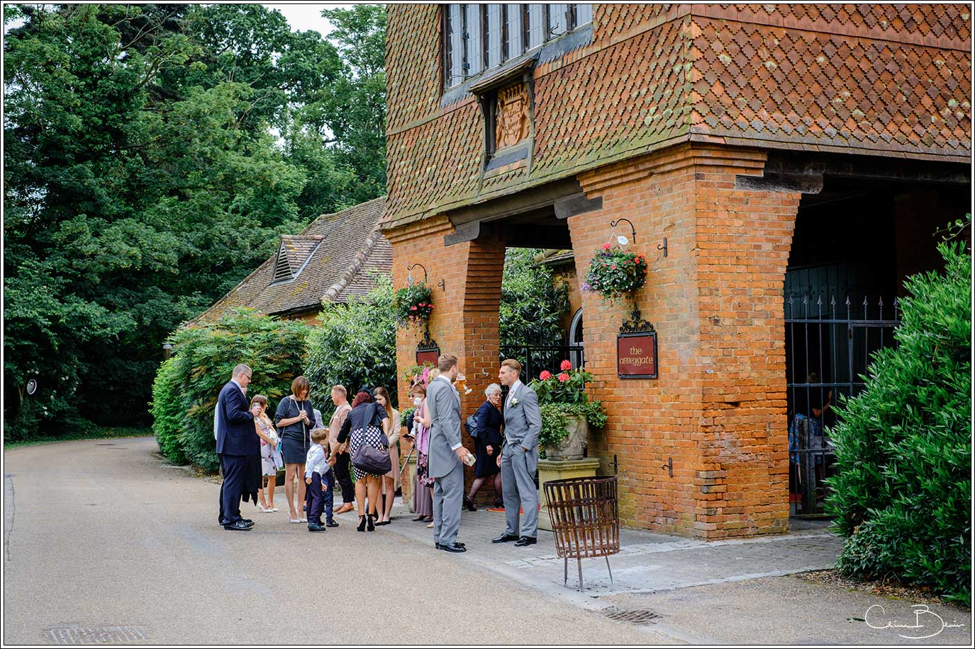 Coombe Abbey wedding photography showing guests waiting outside the Abbeygate