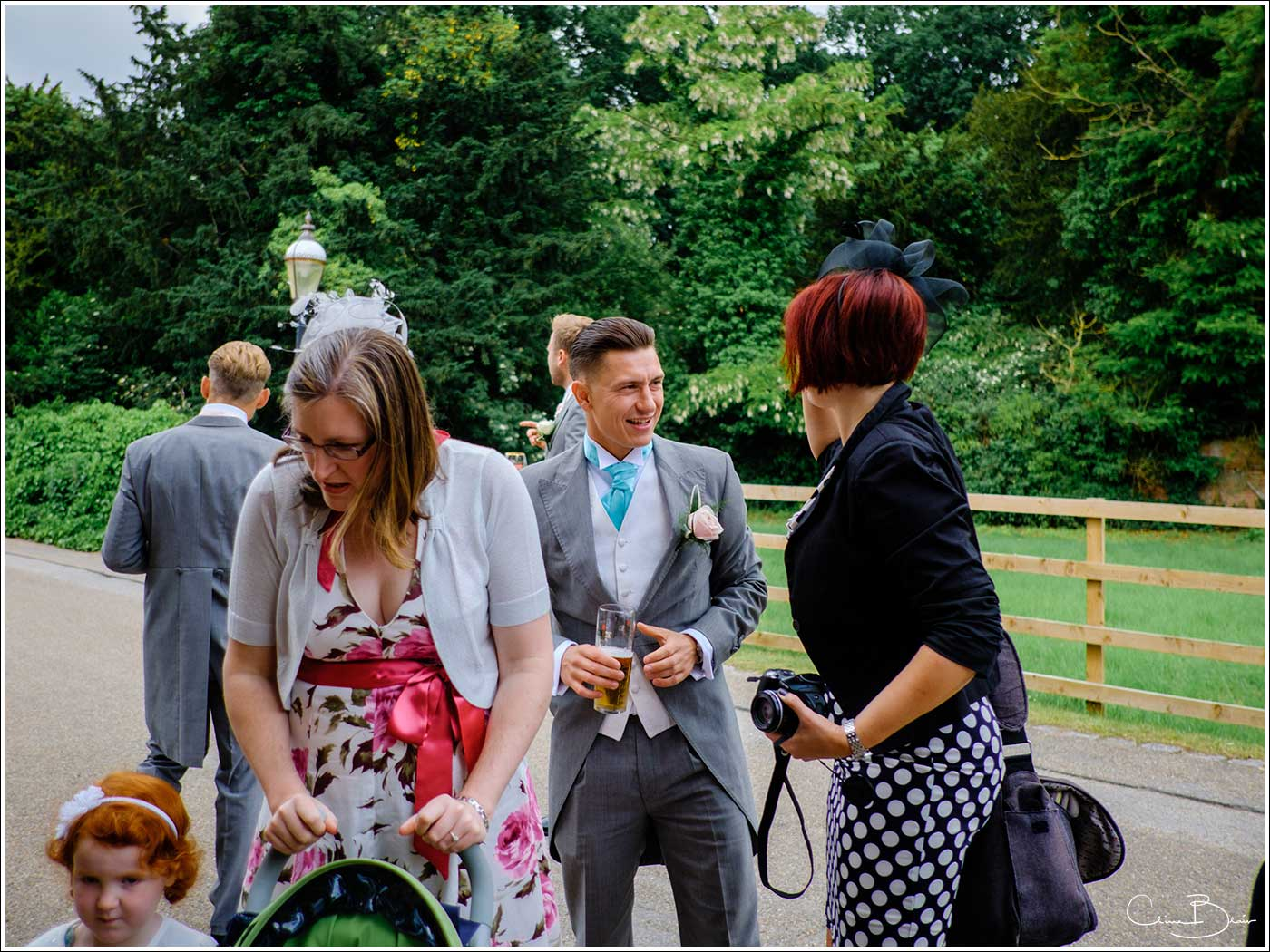 Coombe Abbey wedding photography showing groom greeeting guests at the Abbeygate before the ceremony