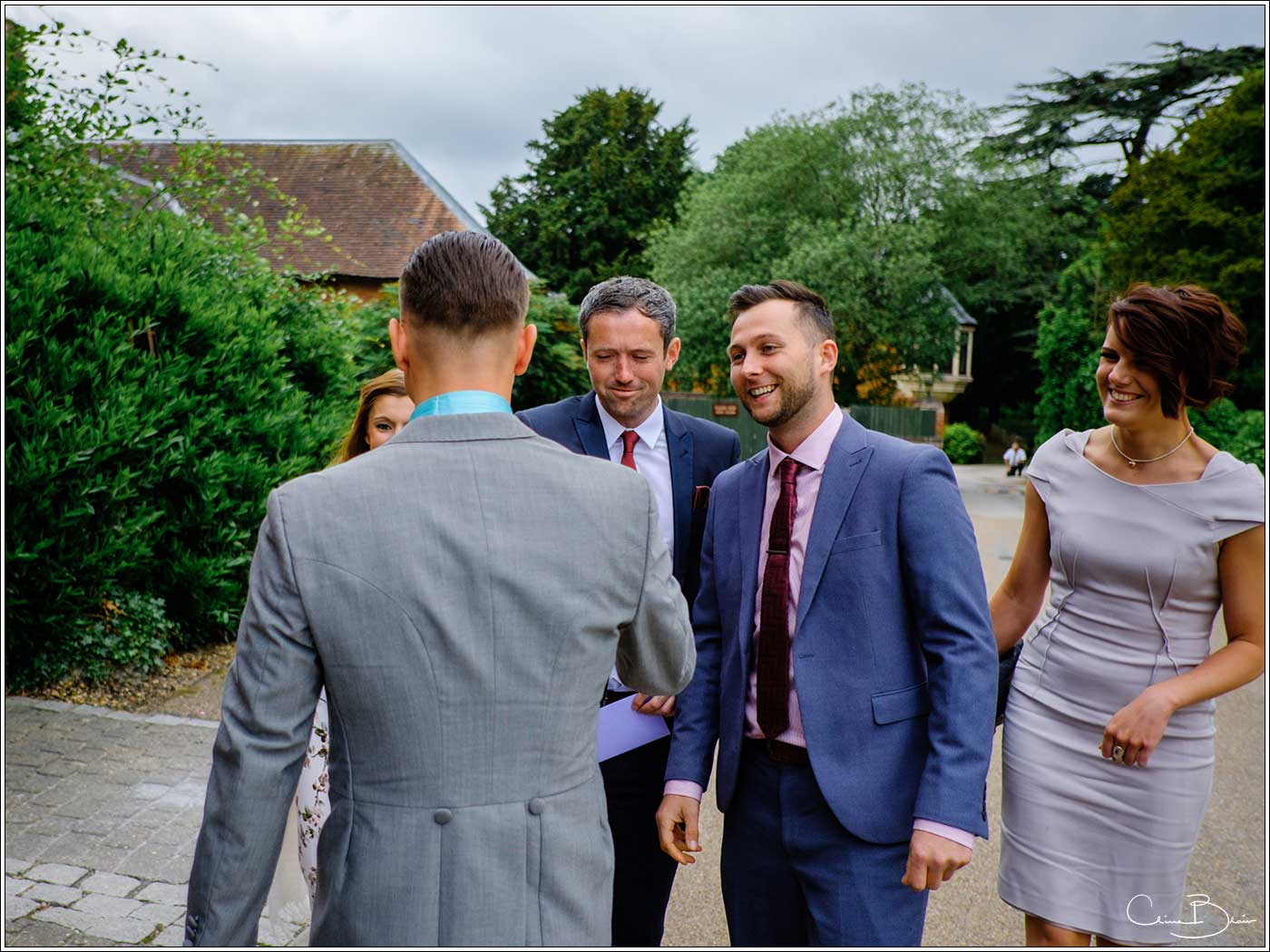 Coombe Abbey wedding photography showing guests arriving at the Abbeygate before the wedding