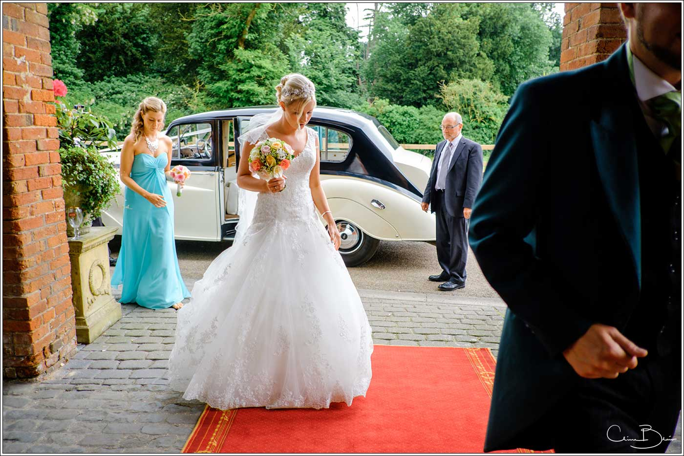 Coombe Abbey wedding photography showing bride entering The Abbeygate