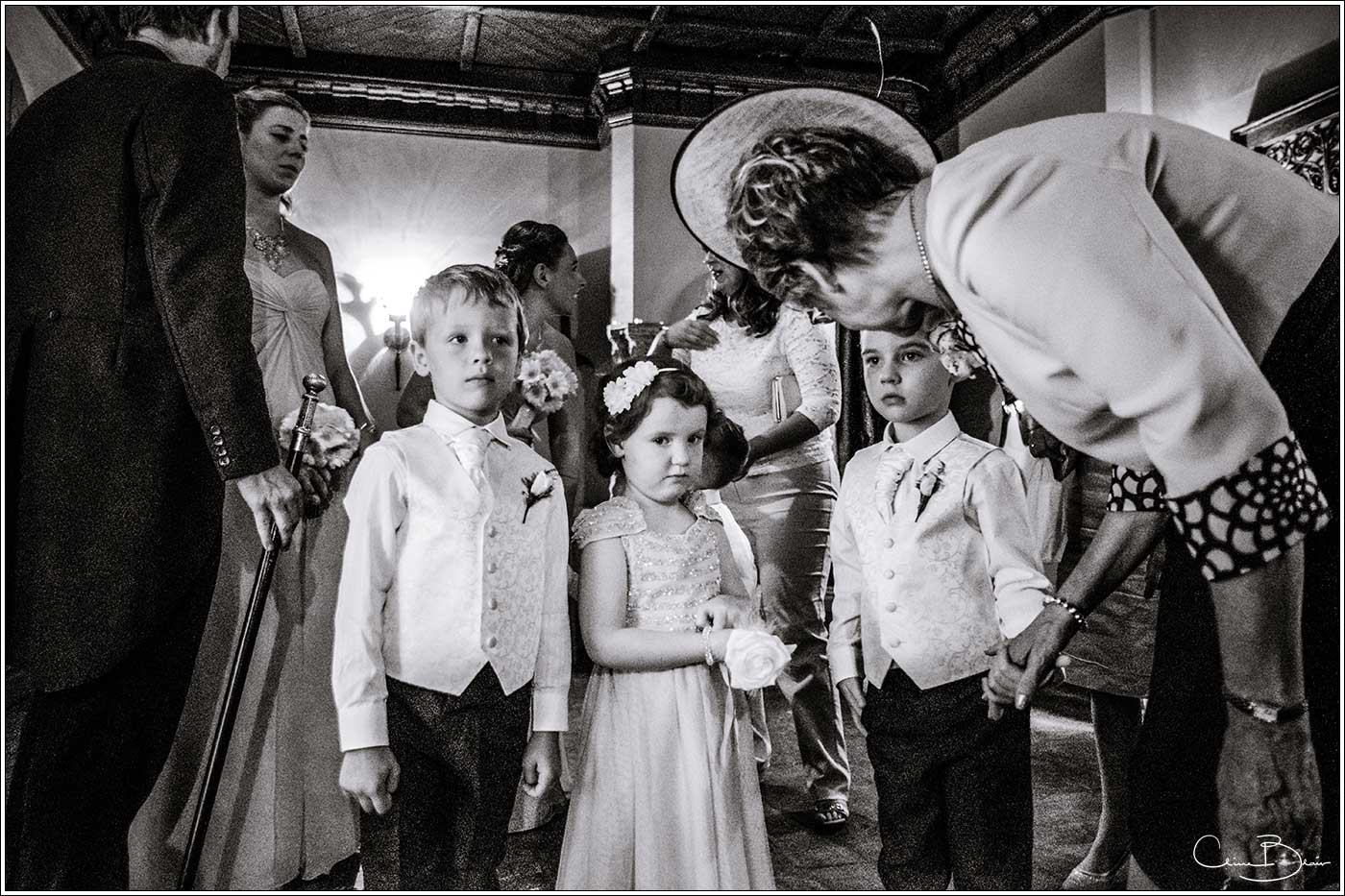 Coombe Abbey wedding photography showing pageboys and flowergirls getting final instructions before entering wedding ceremony in The Abbeygate