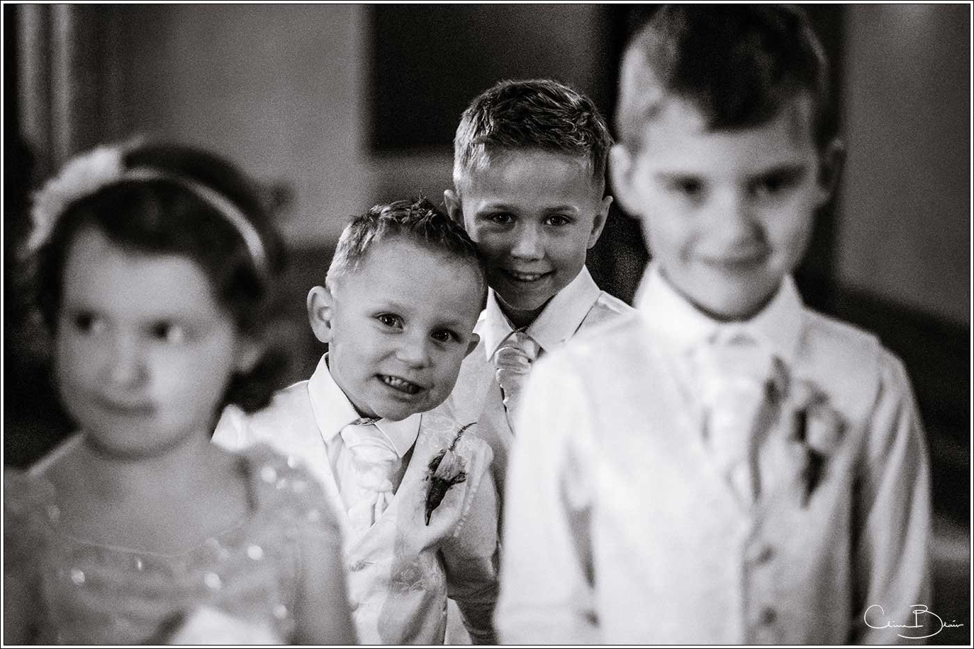 Coombe Abbey wedding photography showing pageboys and flowergirls before the Abbeygate ceremony