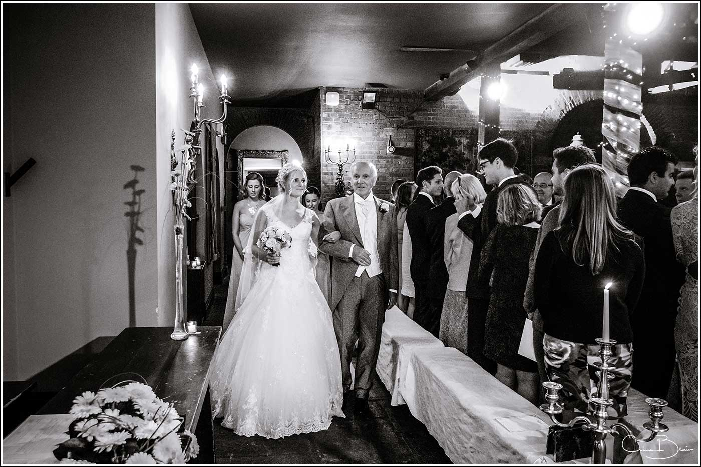 Coombe Abbey wedding photography showing bride entering the wedding ceremony in the Abbeygate