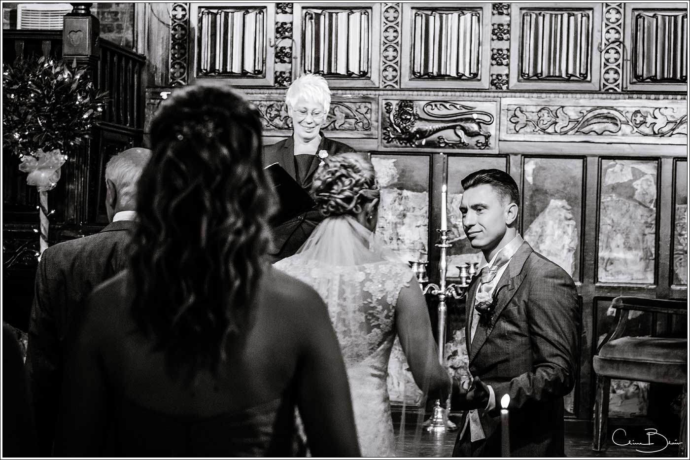 Coombe Abbey wedding photography showing grooming seeing bride for the first time in the Abbeygate