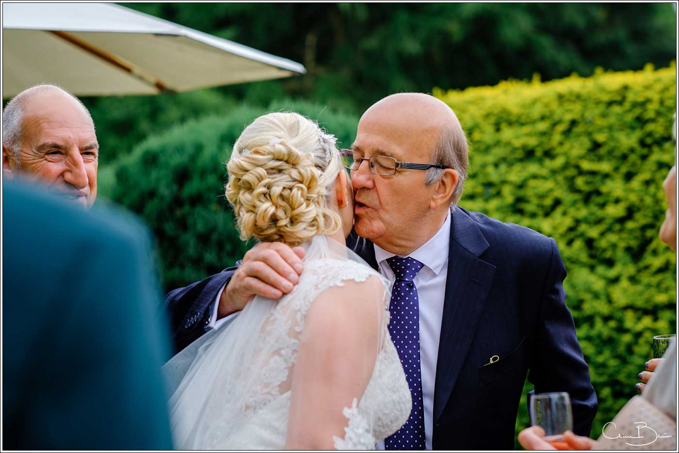 Coombe Abbey wedding photography showing man hugging and kissing bride