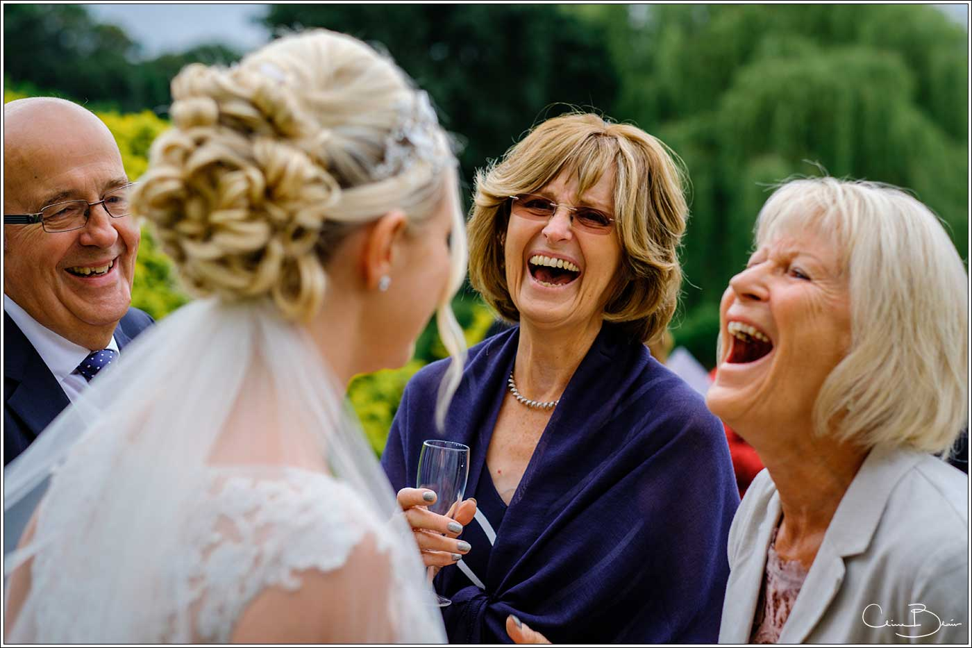 Coombe Abbey wedding photography showing 2 women laughing with bride