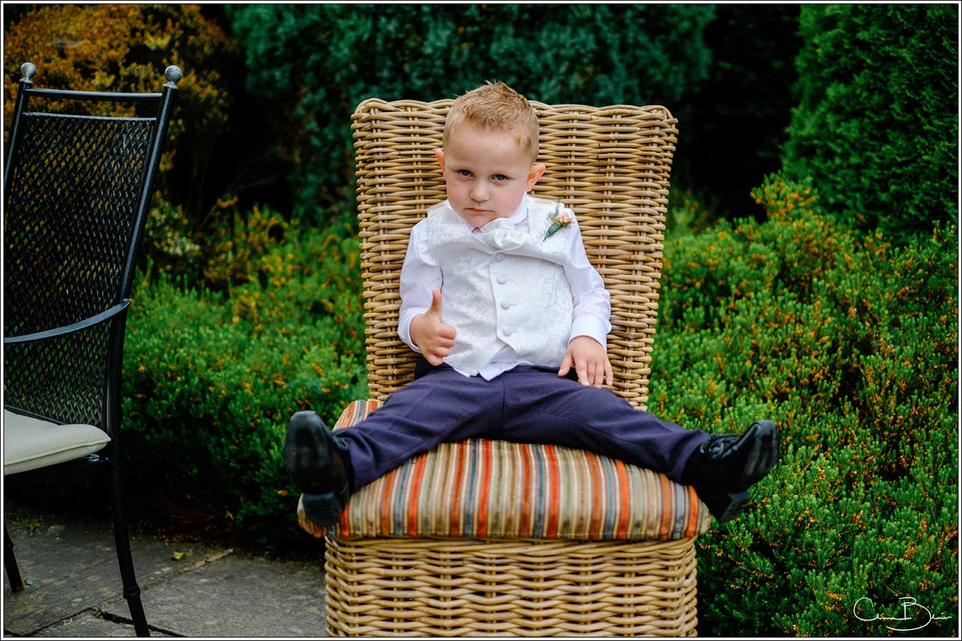Coombe Abbey wedding photography showing child giving a thumbs up to the camera