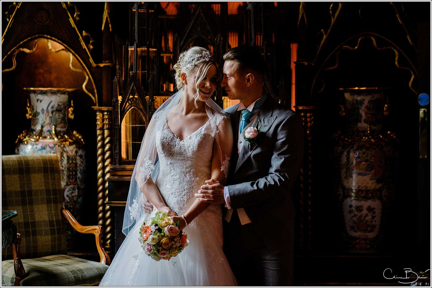 Coombe Abbey wedding photography showing bride and groom in side lighting