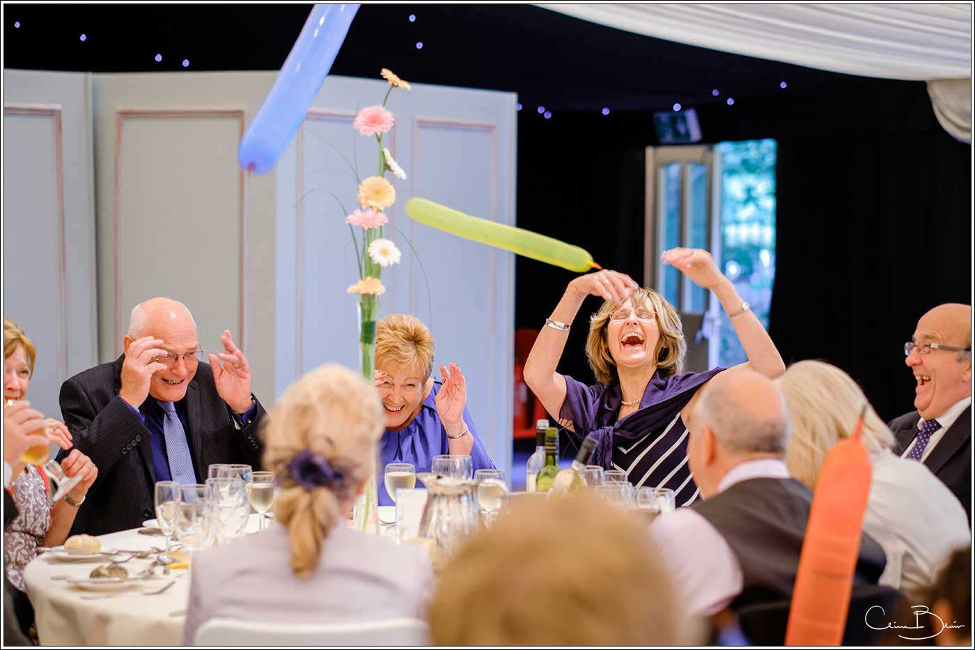 Coombe Abbey wedding photography showing guests letting off their balloons around the reception room