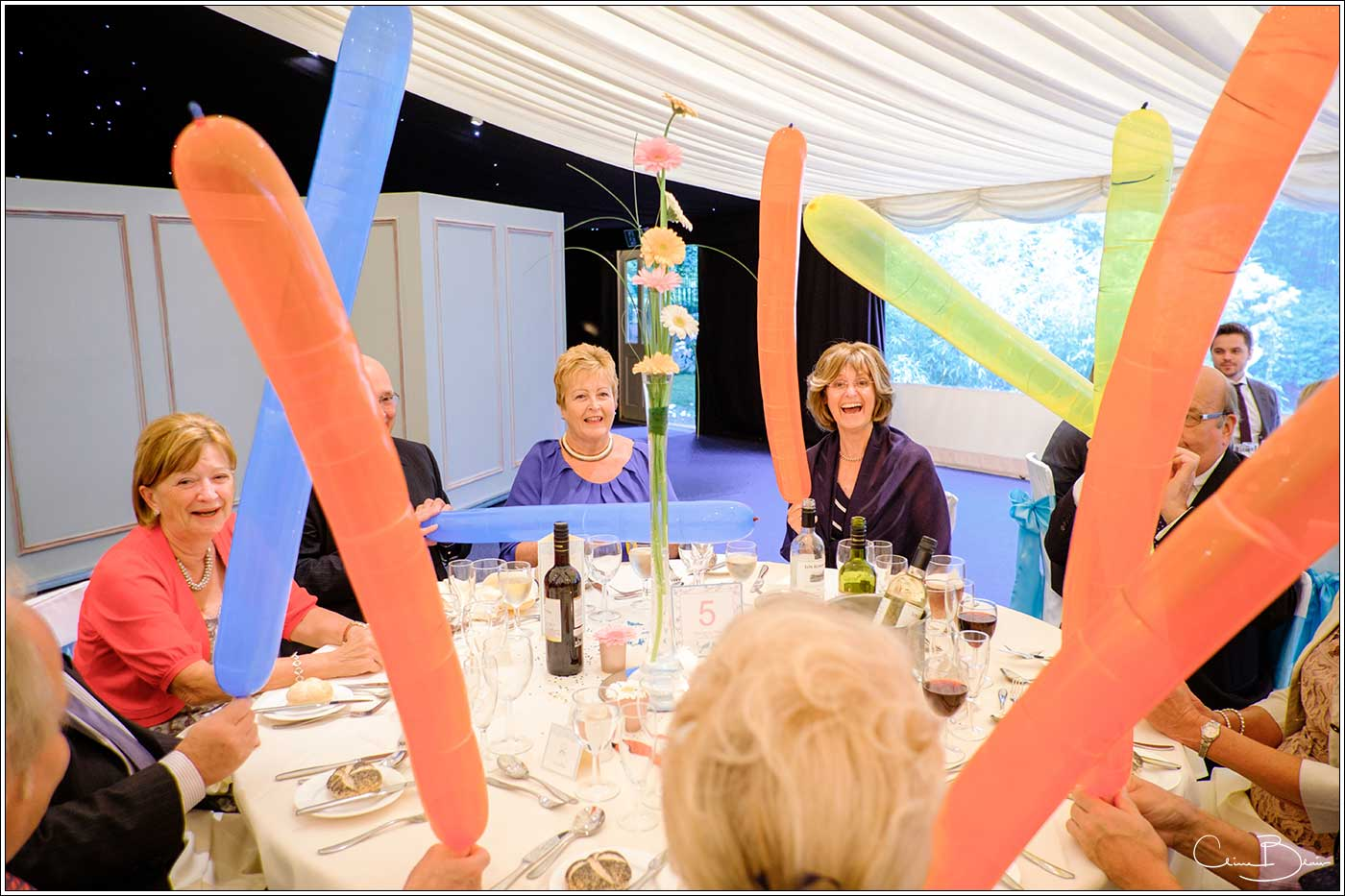 Coombe Abbey wedding photography showing guests playing with balloons