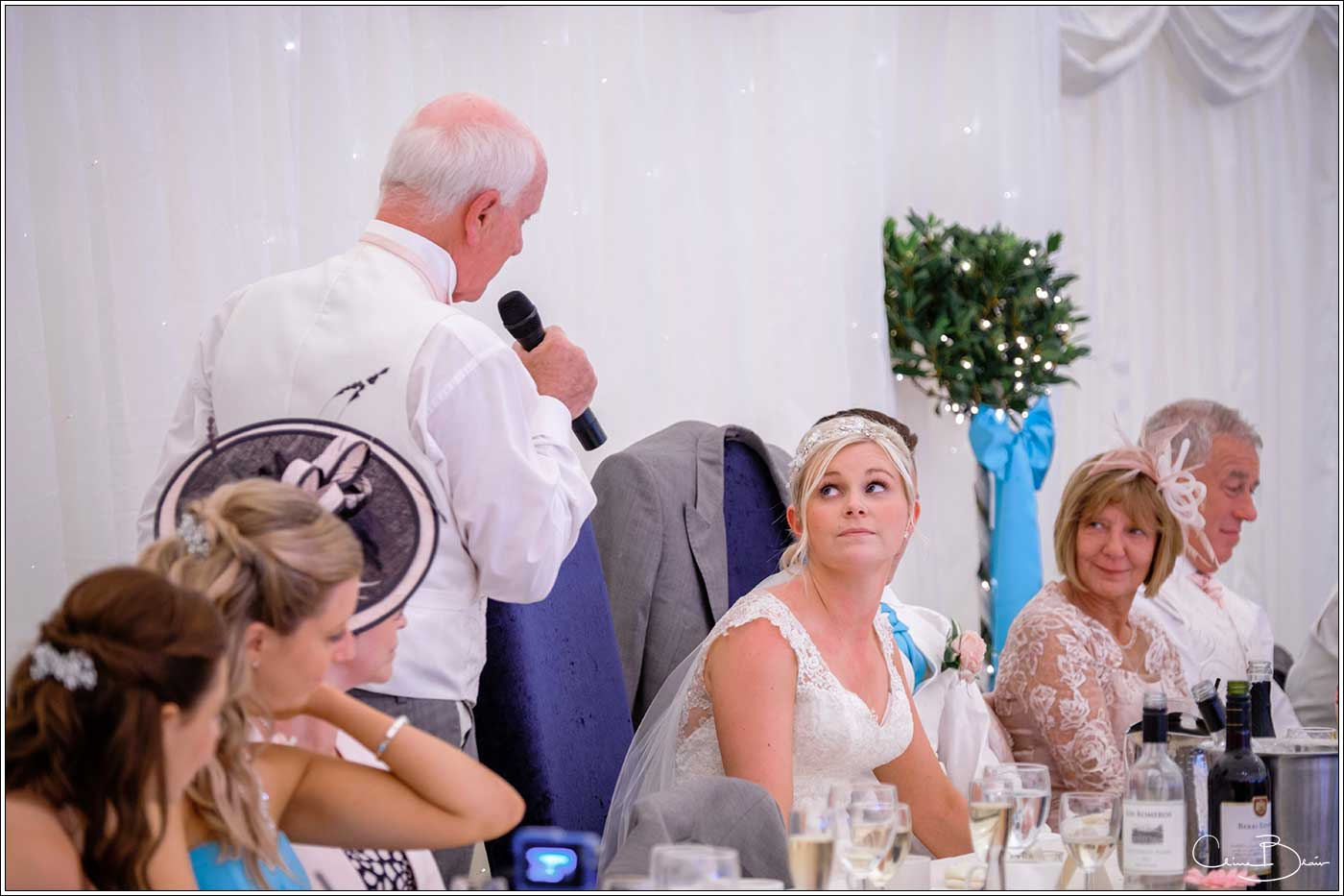 Coombe Abbey wedding photography showing bride listening to her father's speech