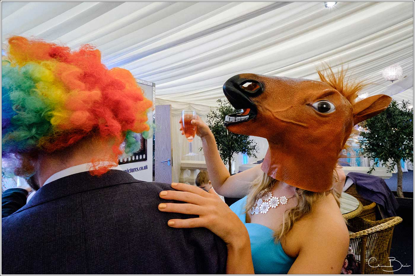Coombe Abbey wedding photography showing guest wearing a photo-booth horses head