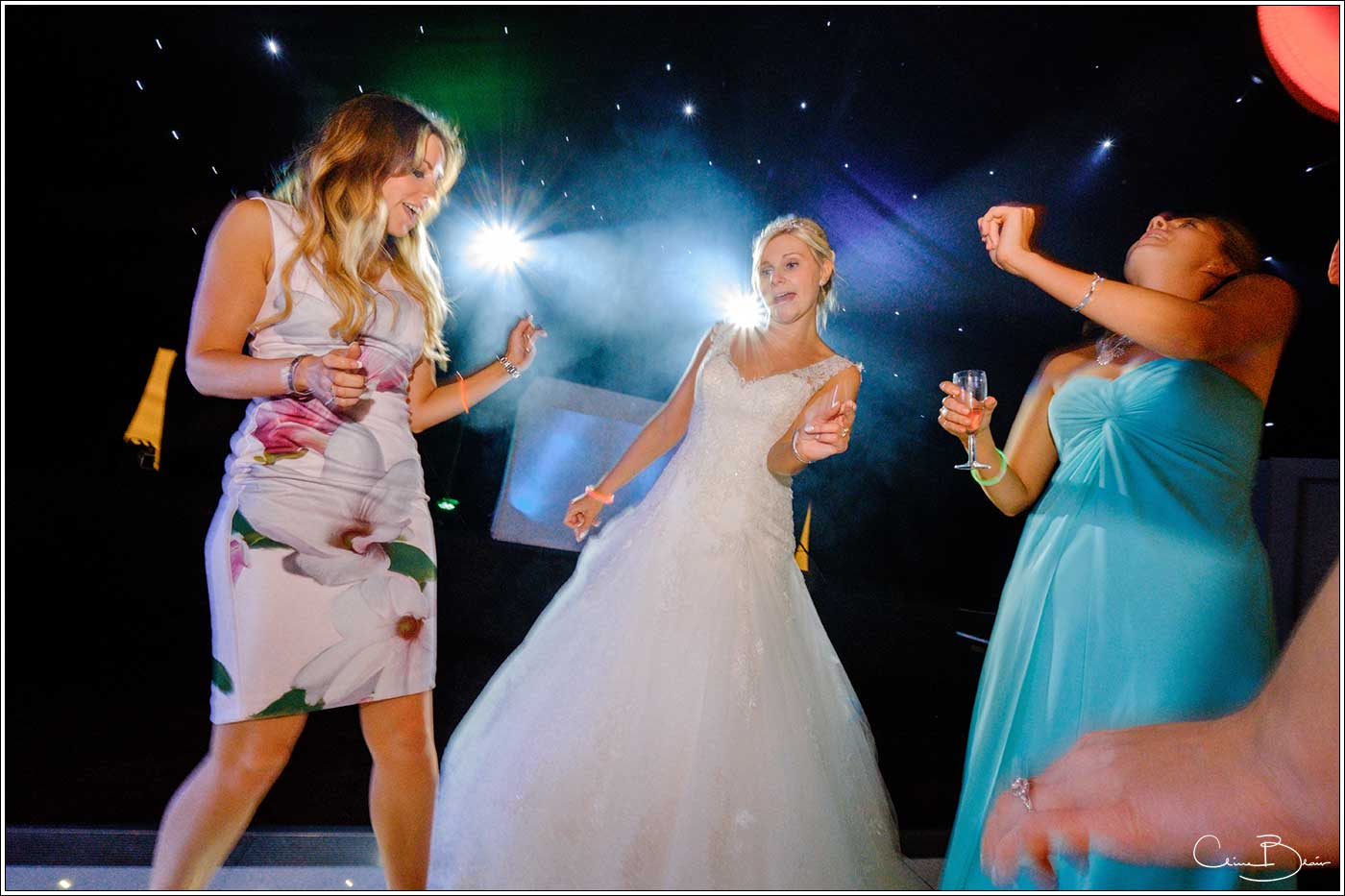 Coombe Abbey wedding photography showing bride dancing on the dance floor
