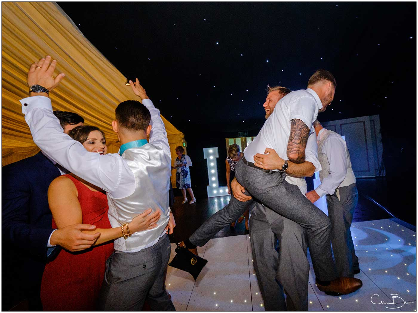 Coombe Abbey wedding photography showing wild antics on the dance floor