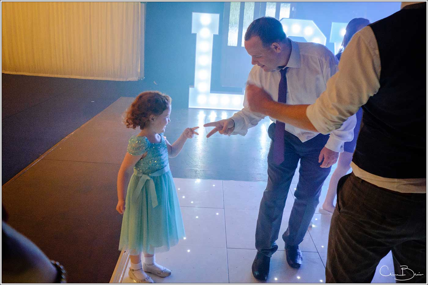 Coombe Abbey wedding photography showing man dancing with a young girl on the dance floor