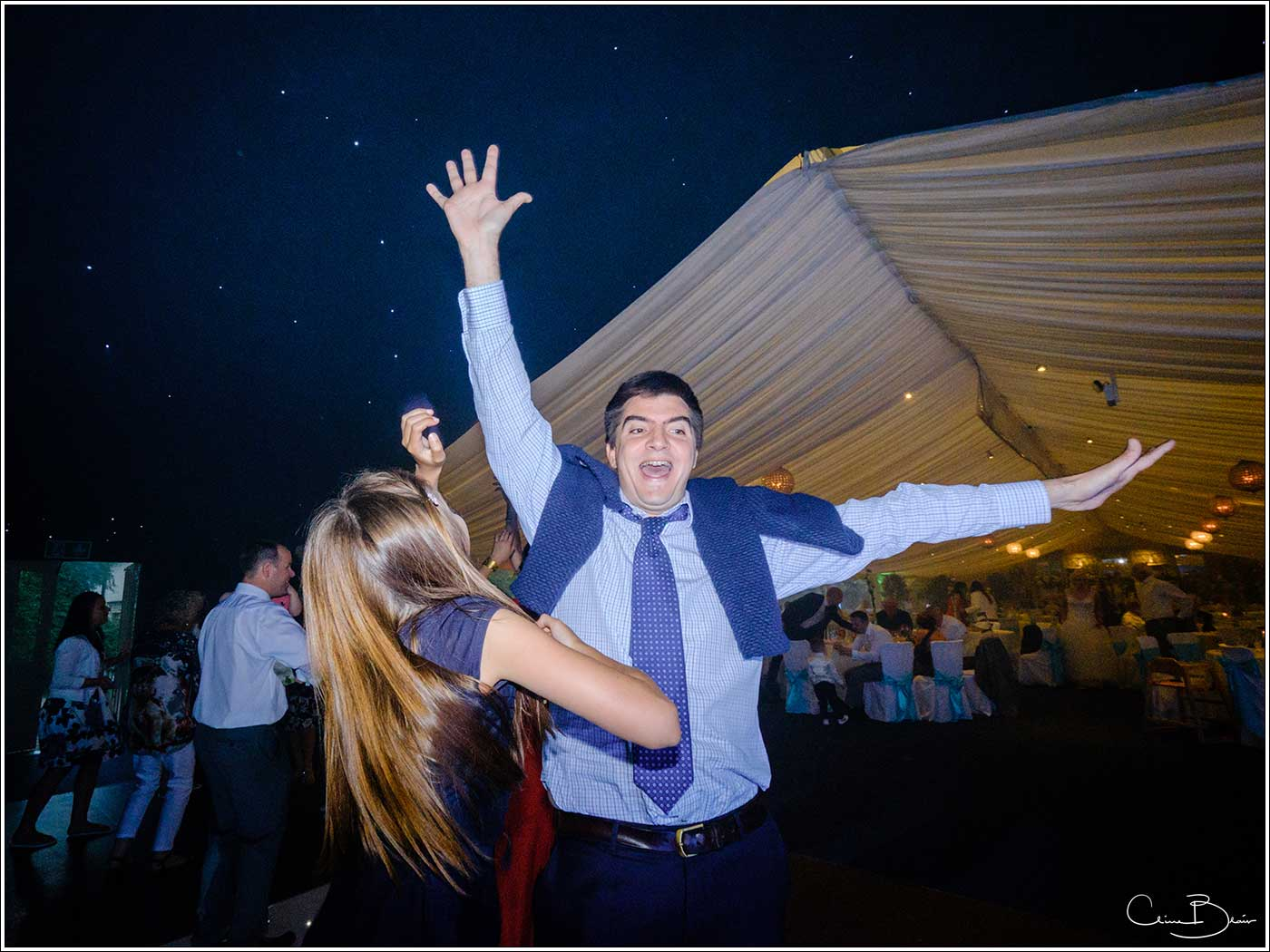 Coombe Abbey wedding photography showing man waving his arms on the dance floor