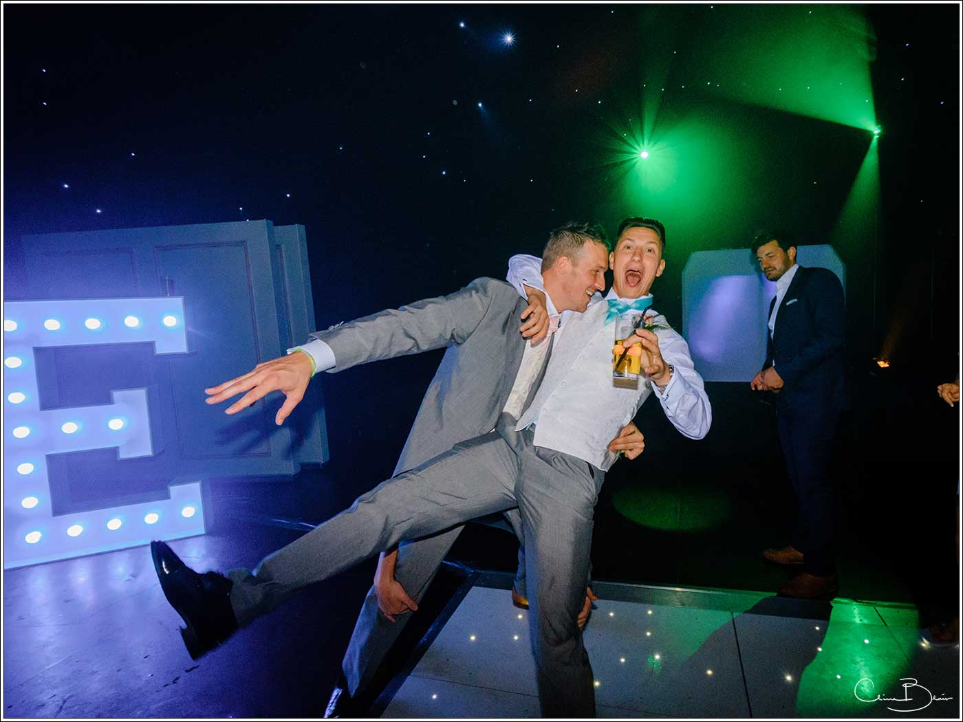 Coombe Abbey wedding photography showing groom and another man on the dance floor