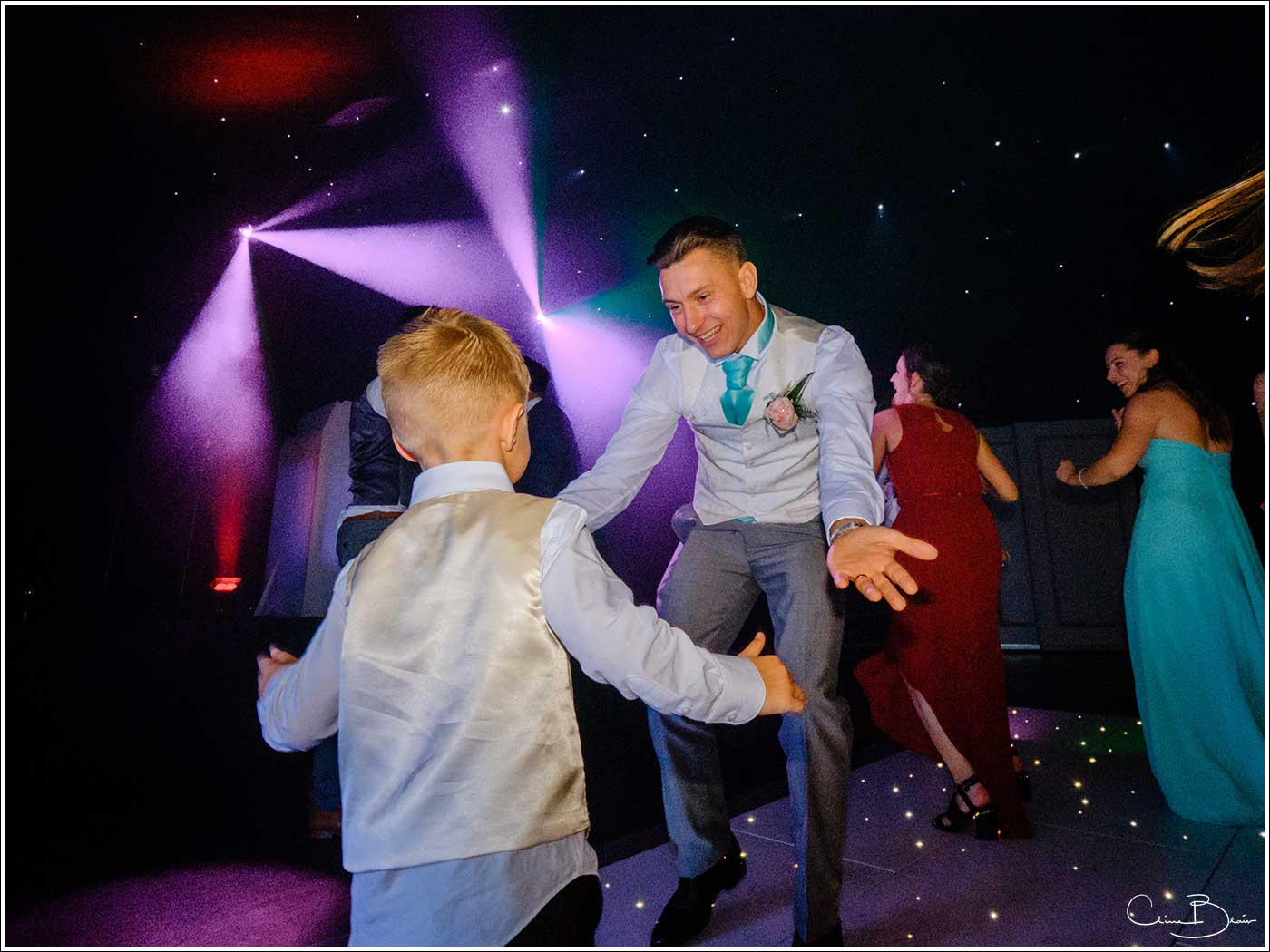 Coombe Abbey wedding photography showing groom dancing with a pageboy on the dance floor
