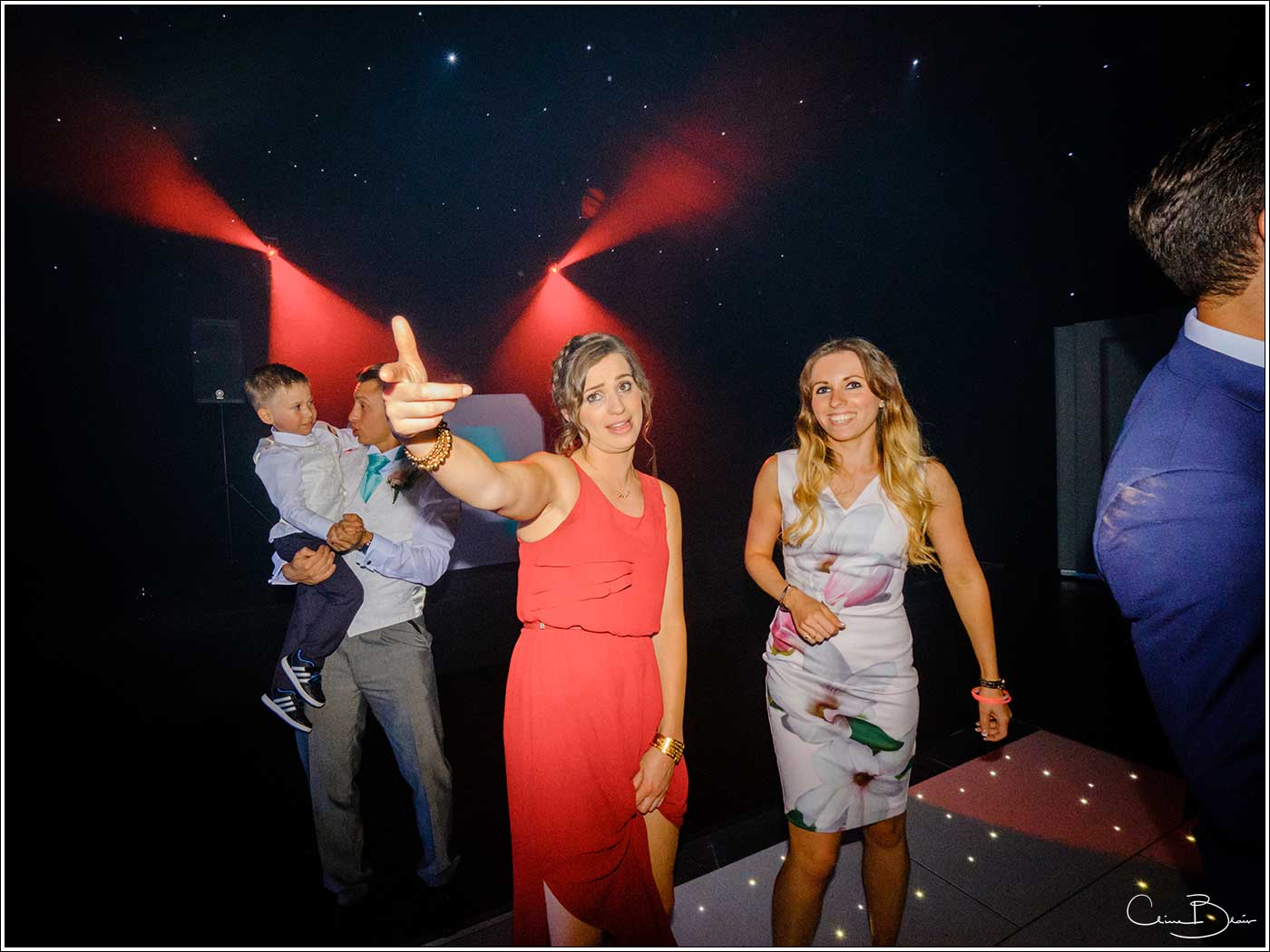 Coombe Abbey wedding photography showing 2 women playing up to the camera on the dance floor