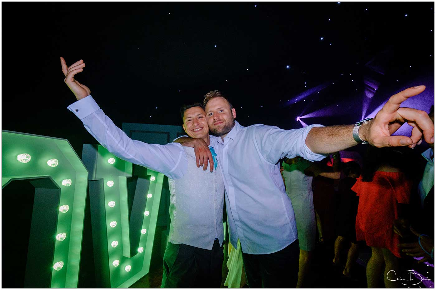 Coombe Abbey wedding photography showing 2 happy men on the dance floor