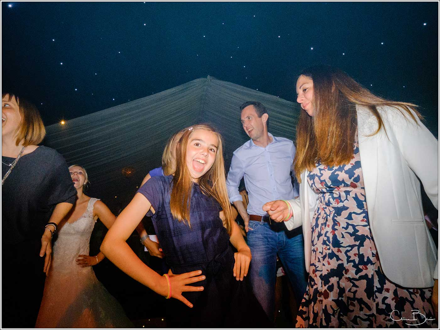 Coombe Abbey wedding photography showing happy child on the dance floor