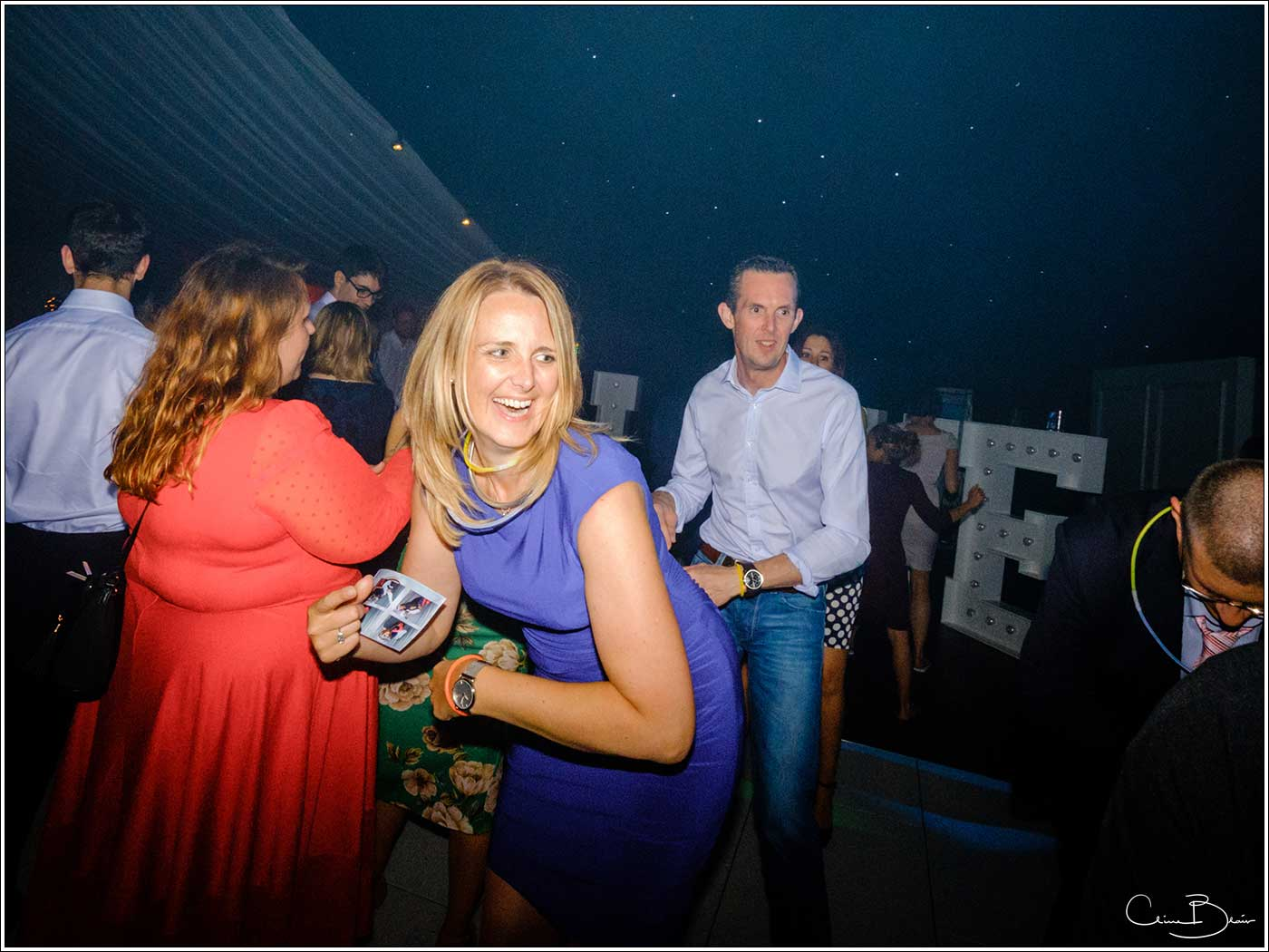Coombe Abbey wedding photography showing happy woman on the dance floor