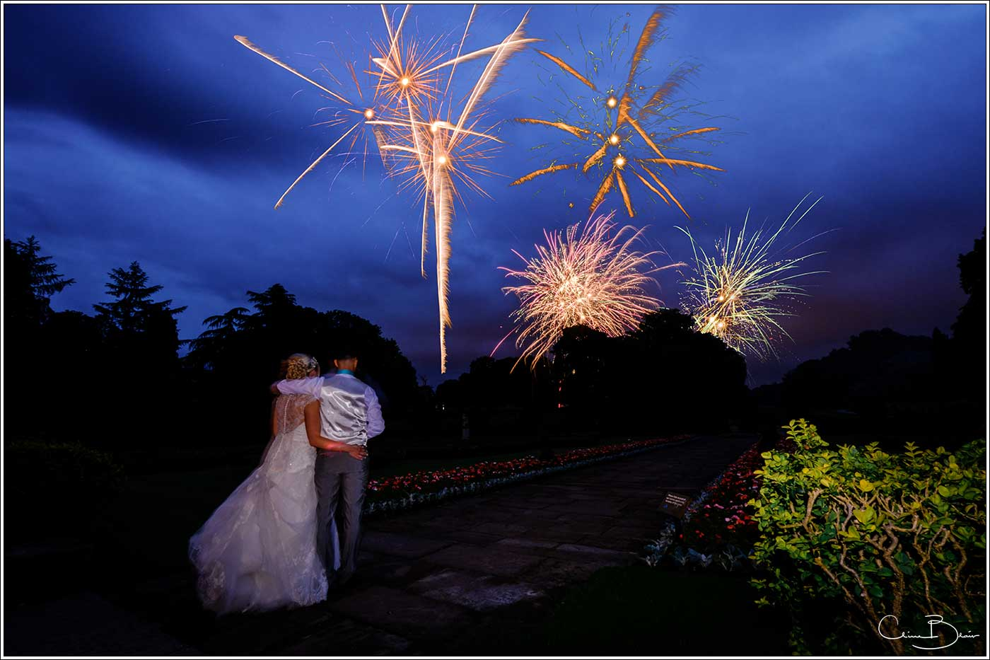 Coombe Abbey wedding photography showing bride and groom watching fireworks