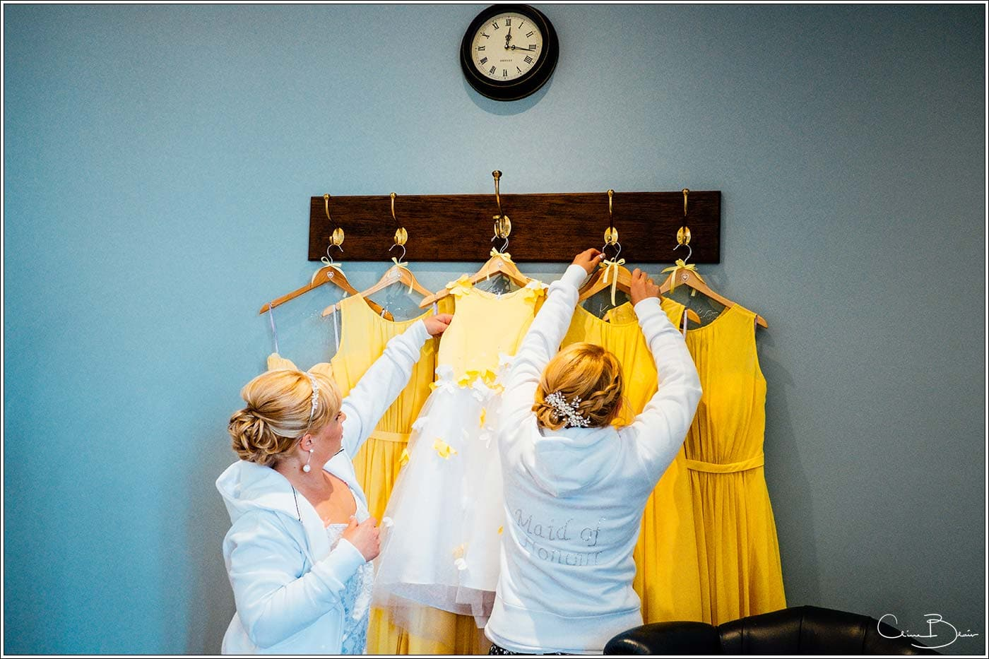 Bride and maids hanging up their dresses at Pendrell Hall as photographed by a recommended Pendrell Hall photographer