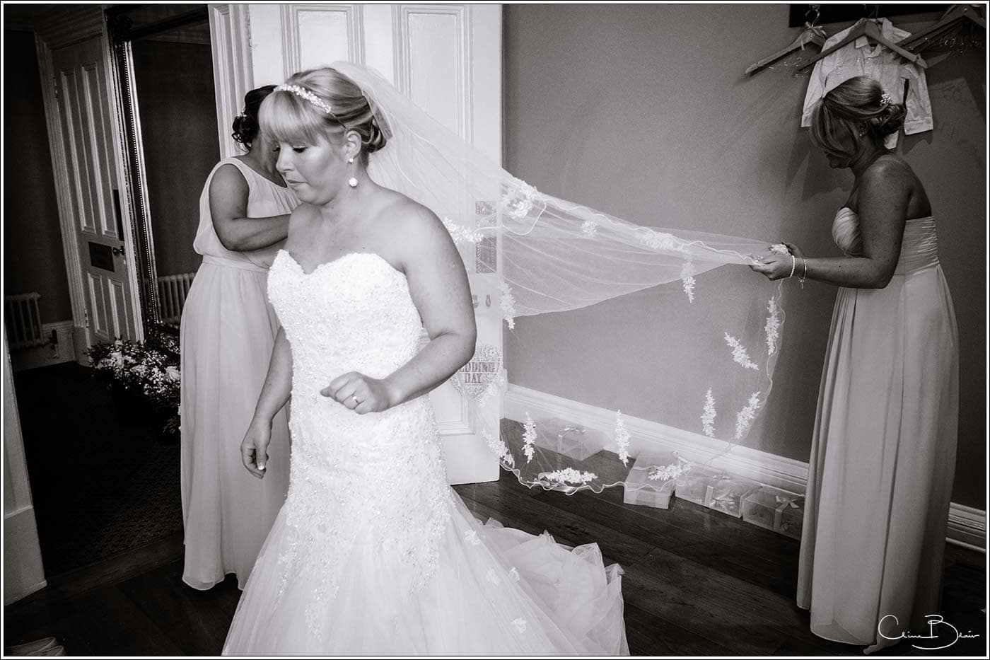 Brides veil being adjusted at Pendrell Hall as photographed by a recommended Pendrell Hall photographer