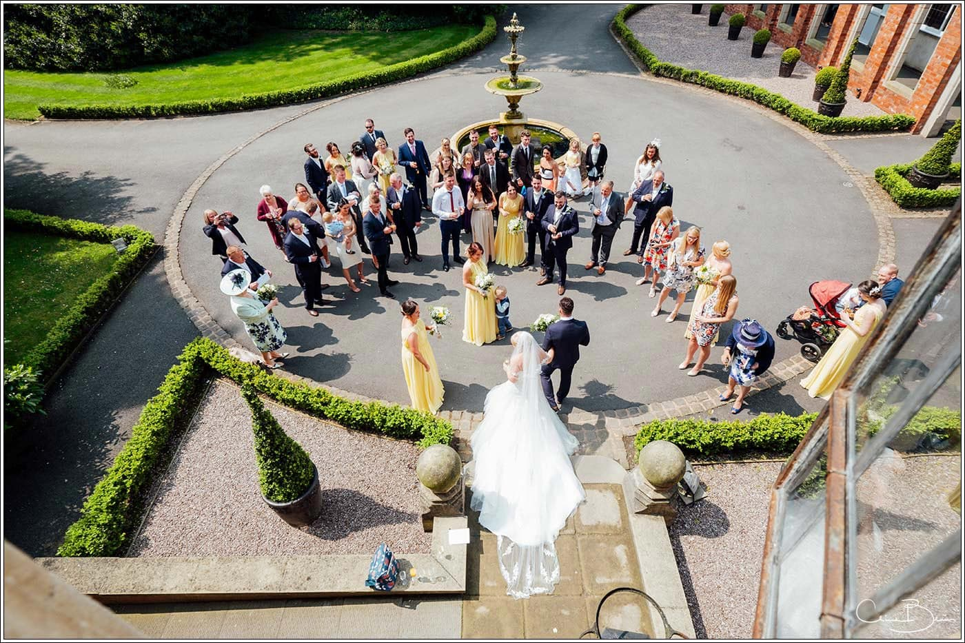 Bride and groom greeting their guests at Pendrell Hall as photographed by a recommended Pendrell Hall photographer