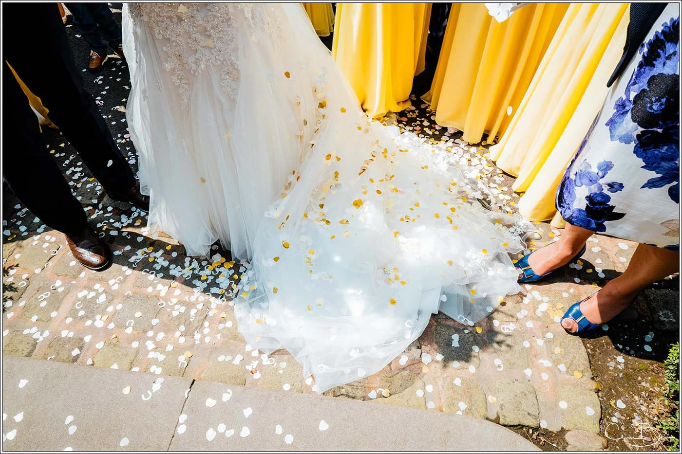 Confetti on the dress at Pendrell Hall as photographed by a recommended Pendrell Hall photographer
