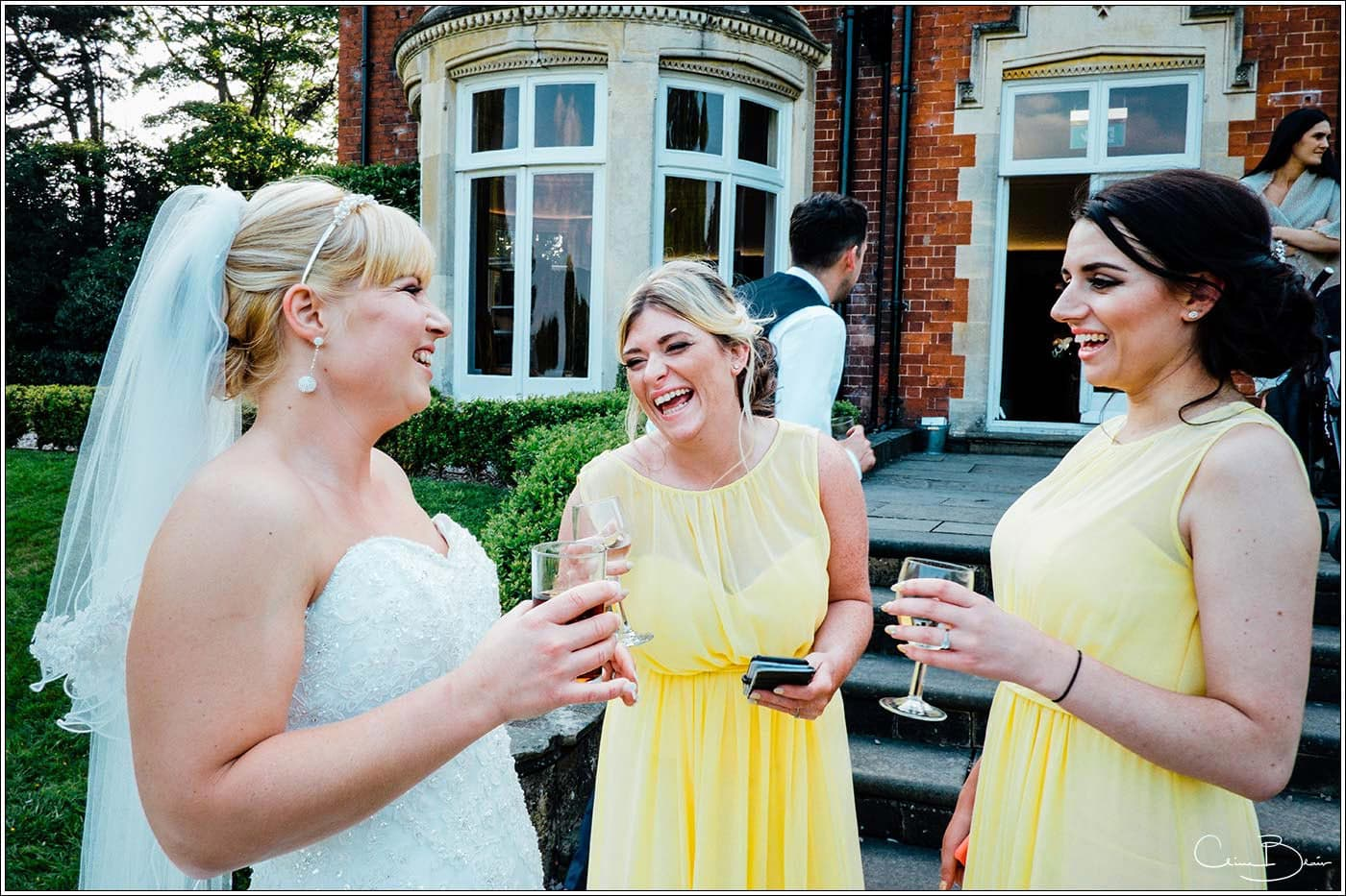 Bride laughing with her maids at Pendrell Hall as photographed by a recommended Pendrell Hall photographer