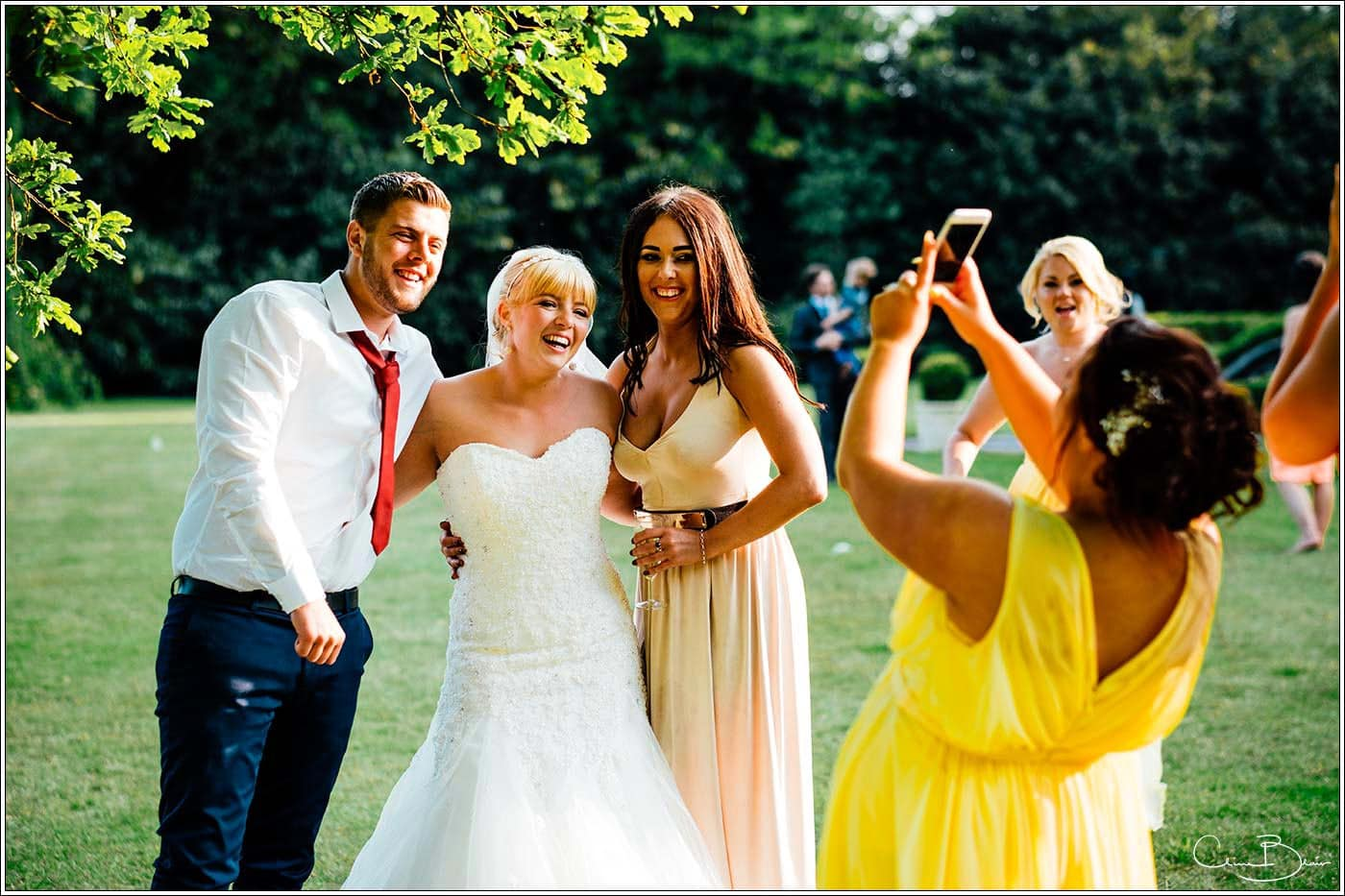 Bride laughing with ther guests as photographed by a recommended Pendrell Hall photographer