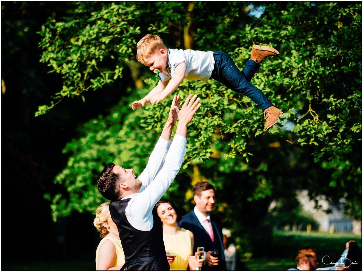 Child being thrown in the air as photographed by a recommended Pendrell Hall photographer