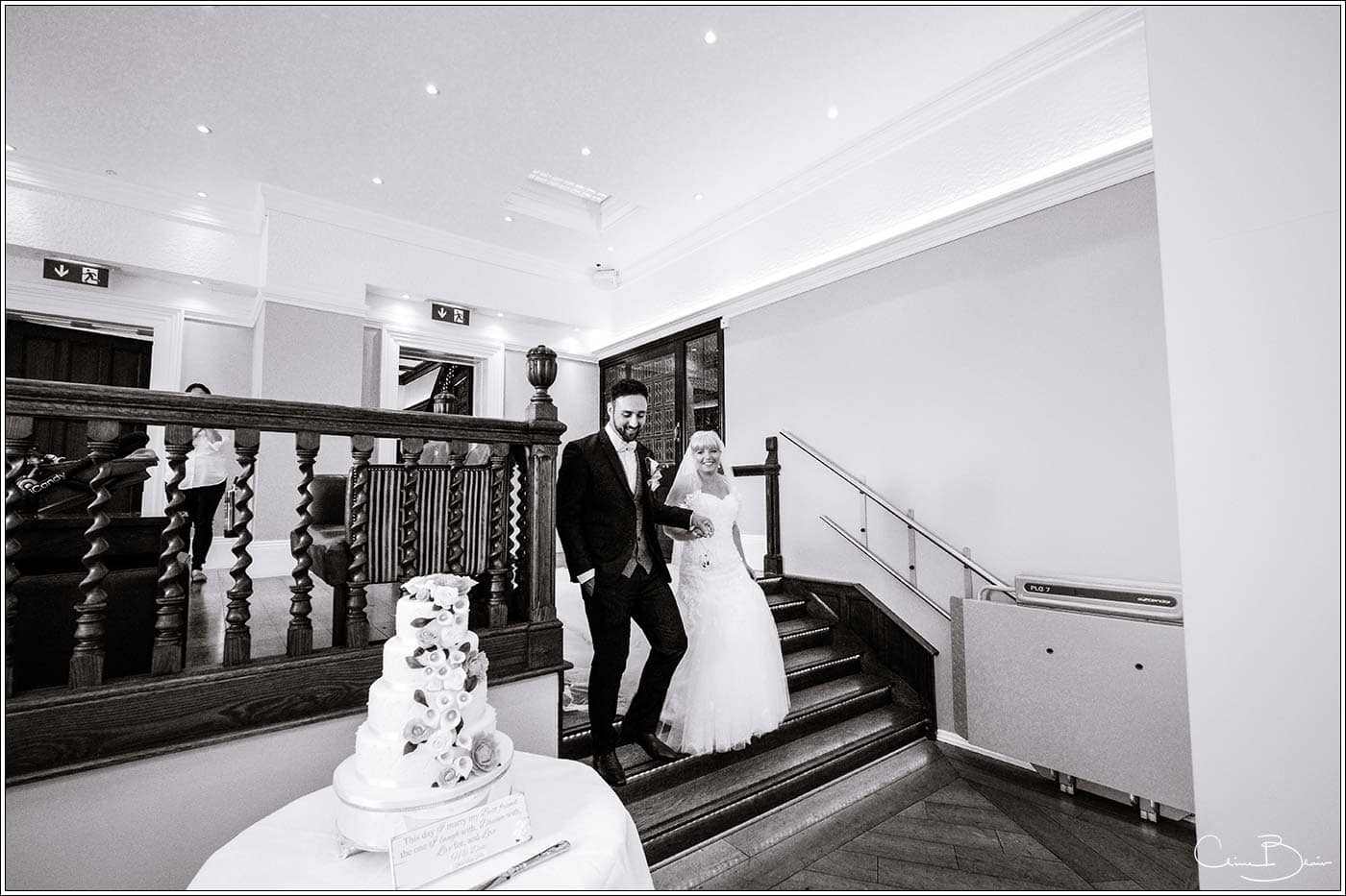 Bride and groom entering the wedding breakfast as photographed by a recommended Pendrell Hall photographer