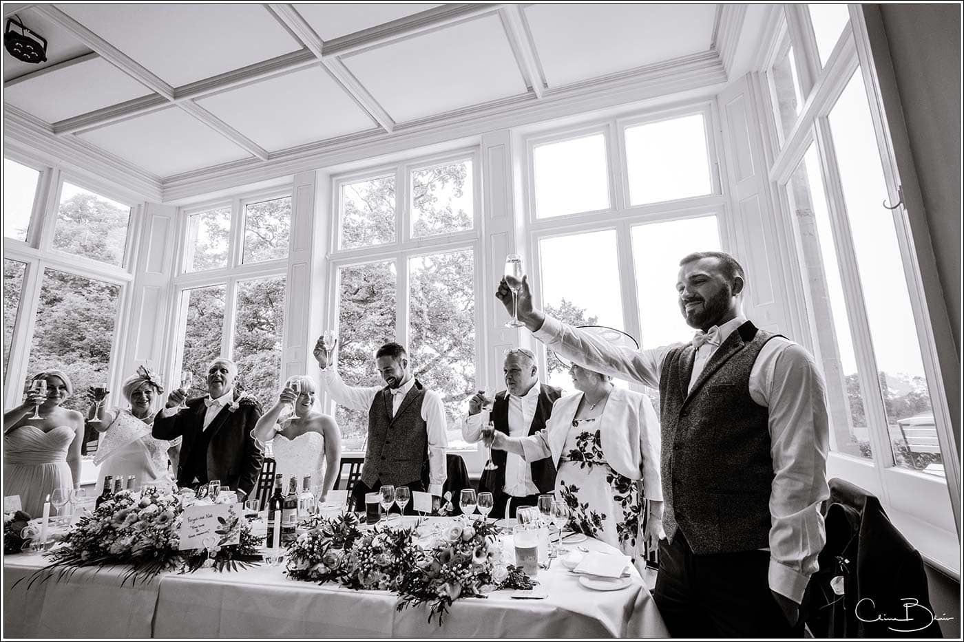 Wedding toast at Pendrell Hall as photographed by a recommended Pendrell Hall photographer