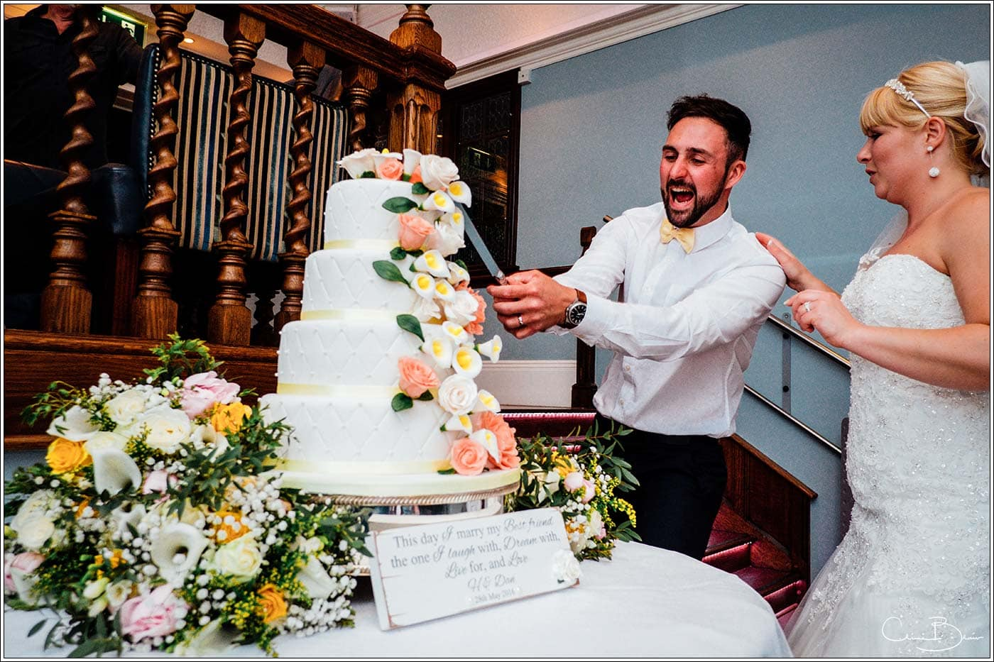 Groom attacking cake as photographed by a recommended Pendrell Hall photographer