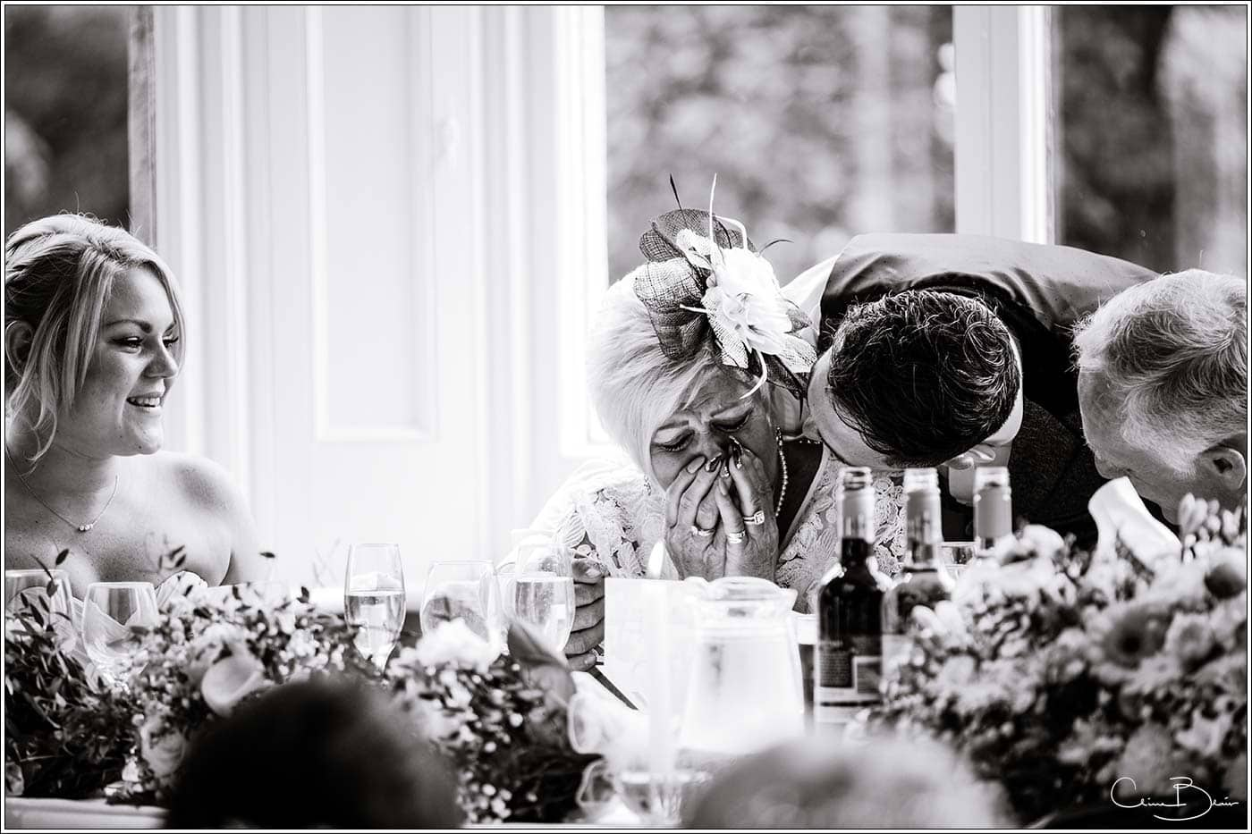 Tearful mother of bride during the speeches by Pendrell Hall wedding photographer Clive Blair