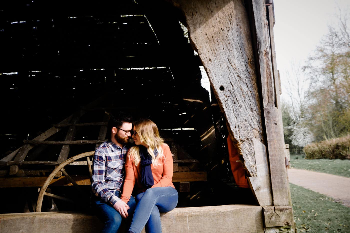 Engaged couple inside Avoncroft Museum barn as photographed by Avoncroft Museum pre-wedding shoot photographer Clive Blair