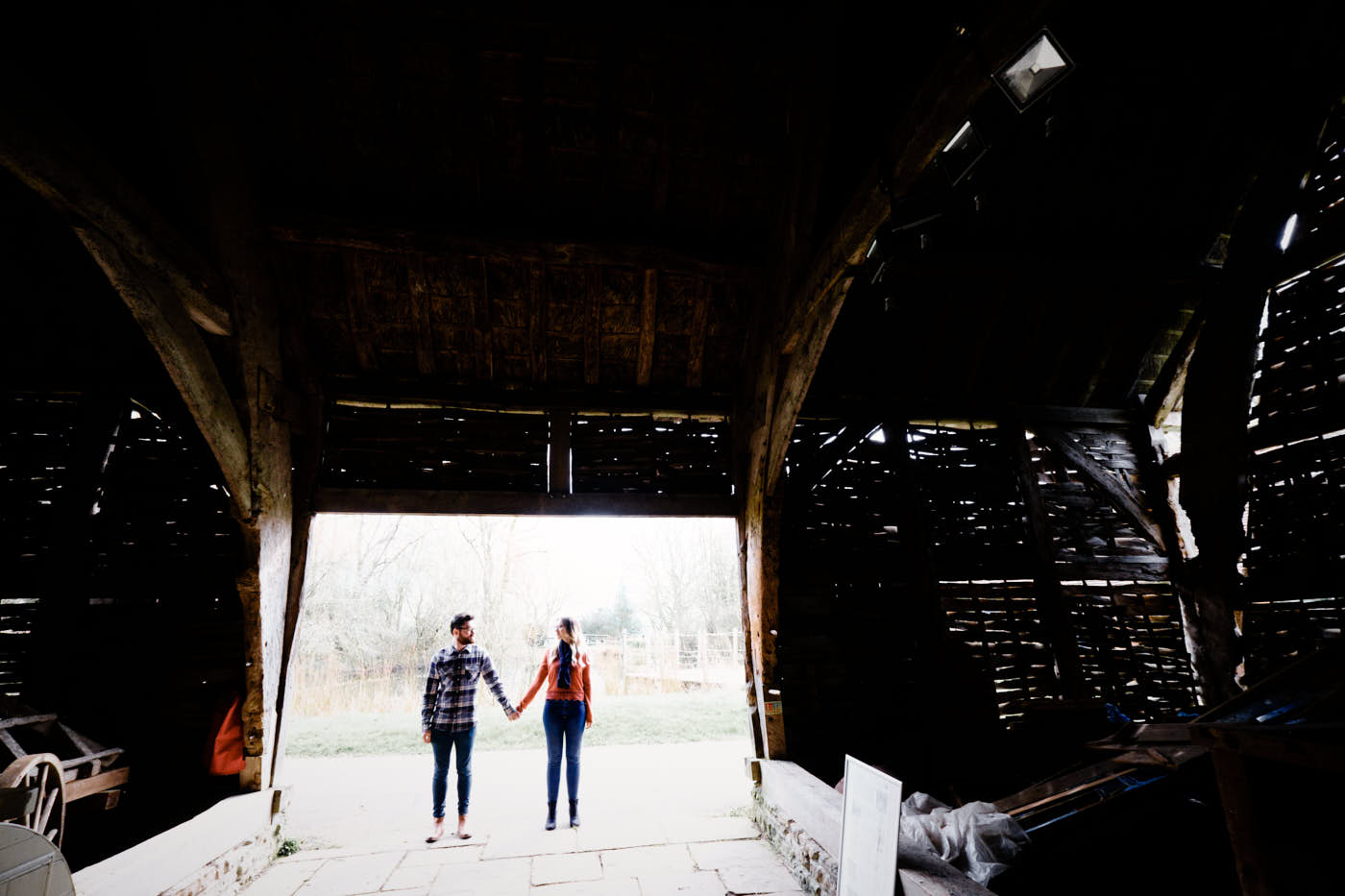 Engaged couple by Avoncroft Museum barn as photographed by Avoncroft Museum pre-wedding shoot photographer Clive Blair