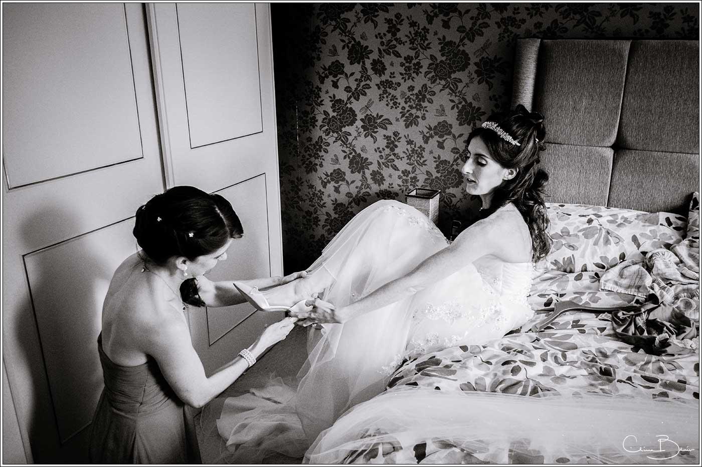 Bride putting on wedding shoes: Bank House Wedding Photographer Clive Blair Photography. Documentary Birmingham Wedding Photographer