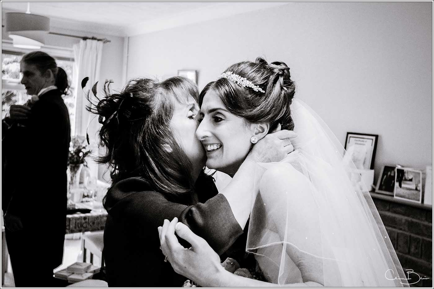 Bride being kissed by mother: Bank House Wedding Photographer Clive Blair Photography. Documentary Birmingham Wedding Photographer