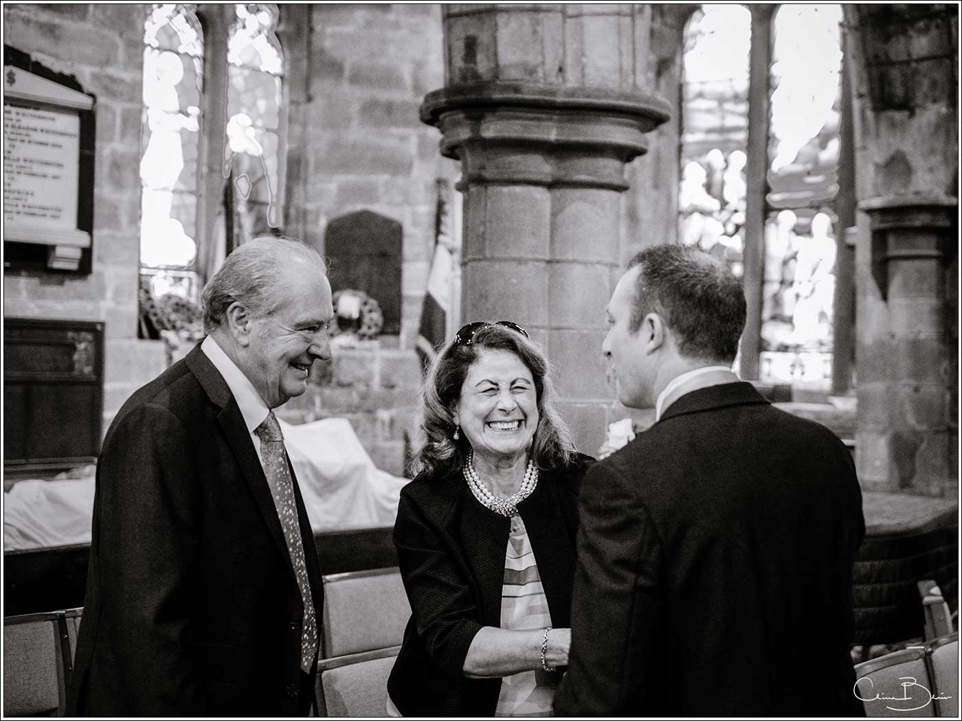 Wedding guests greeting groom: Bank House Wedding Photographer Clive Blair Photography. Documentary Birmingham Wedding Photographer
