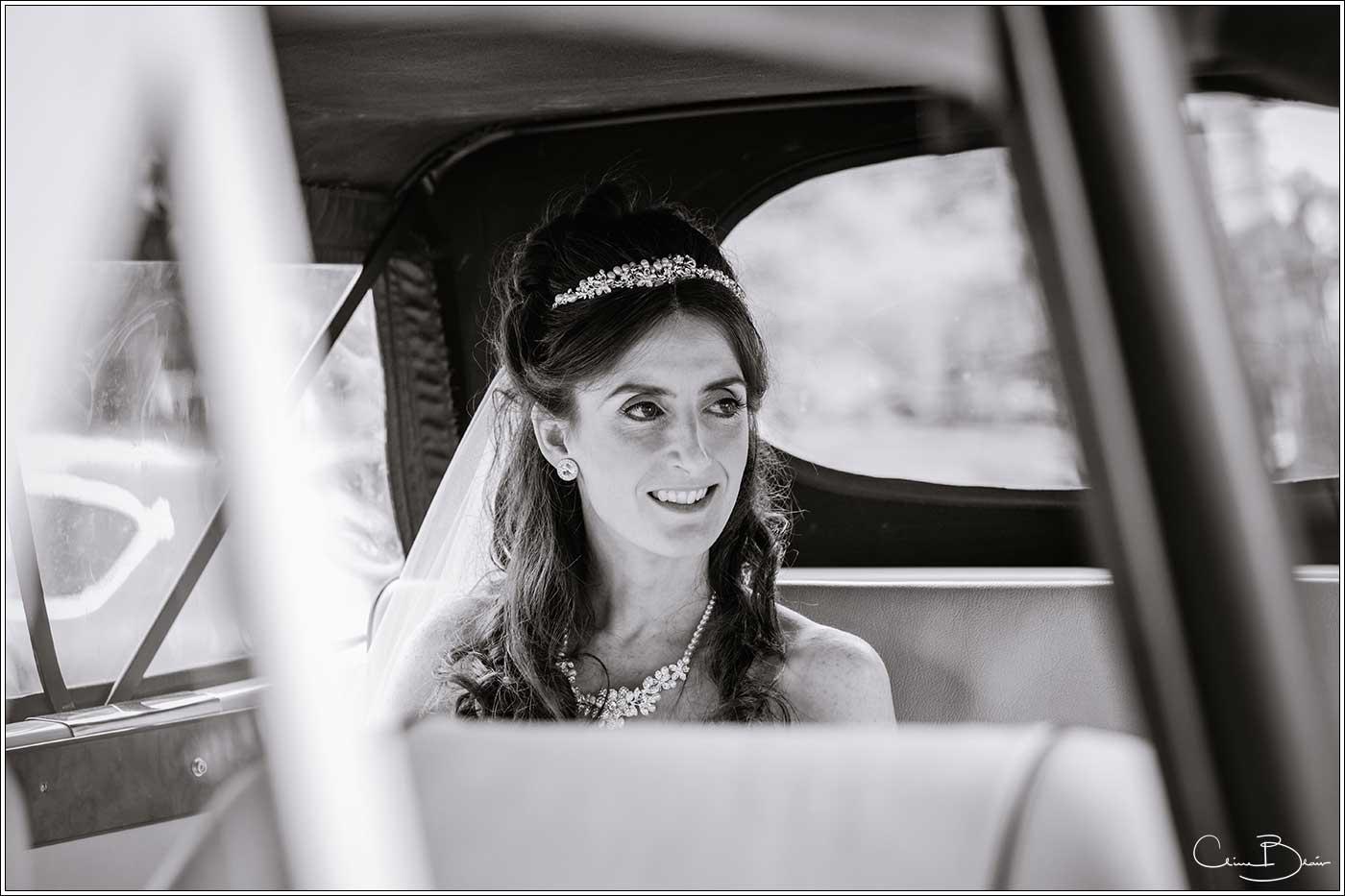 Bride arrivng in wedding car: Bank House Wedding Photographer Clive Blair Photography. Documentary Birmingham Wedding Photographer