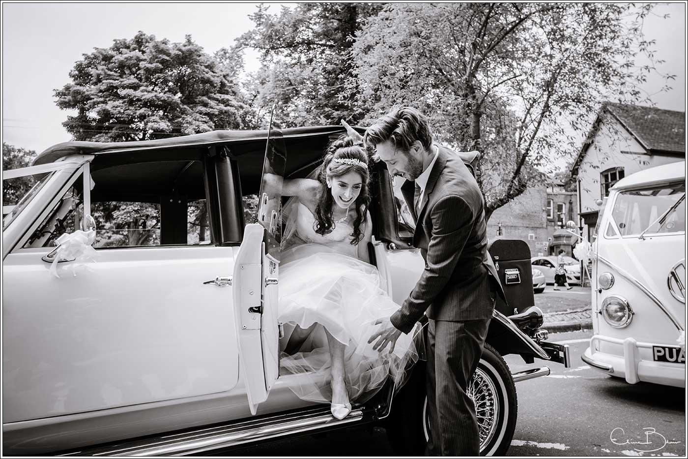 Bride getting out of wedding car: Bank House Wedding Photographer Clive Blair Photography. Documentary Birmingham Wedding Photographer