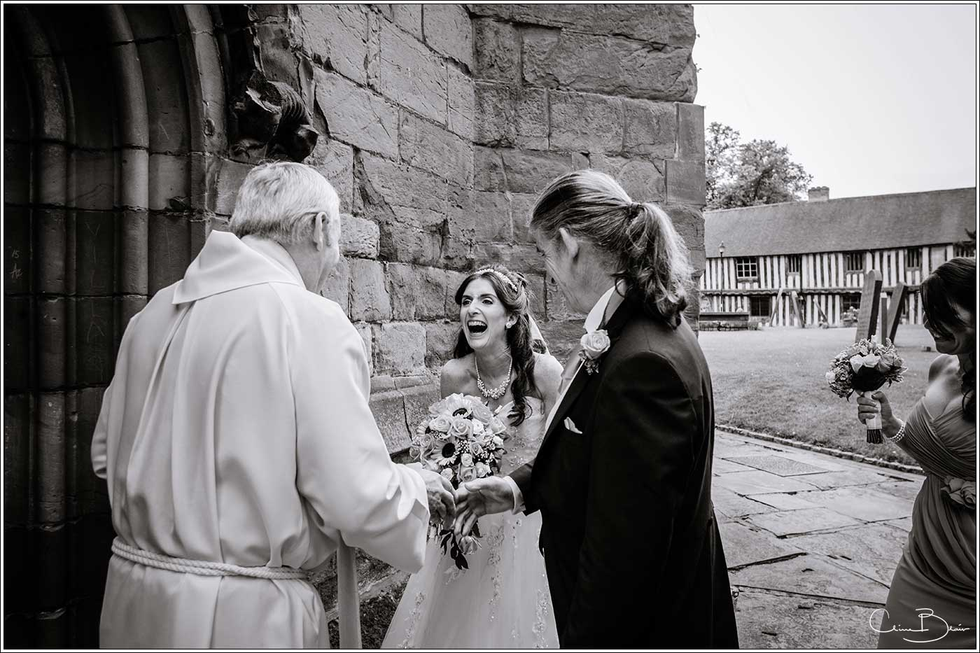 Bride laughing with priest: Bank House Wedding Photographer Clive Blair Photography. Documentary Birmingham Wedding Photographer