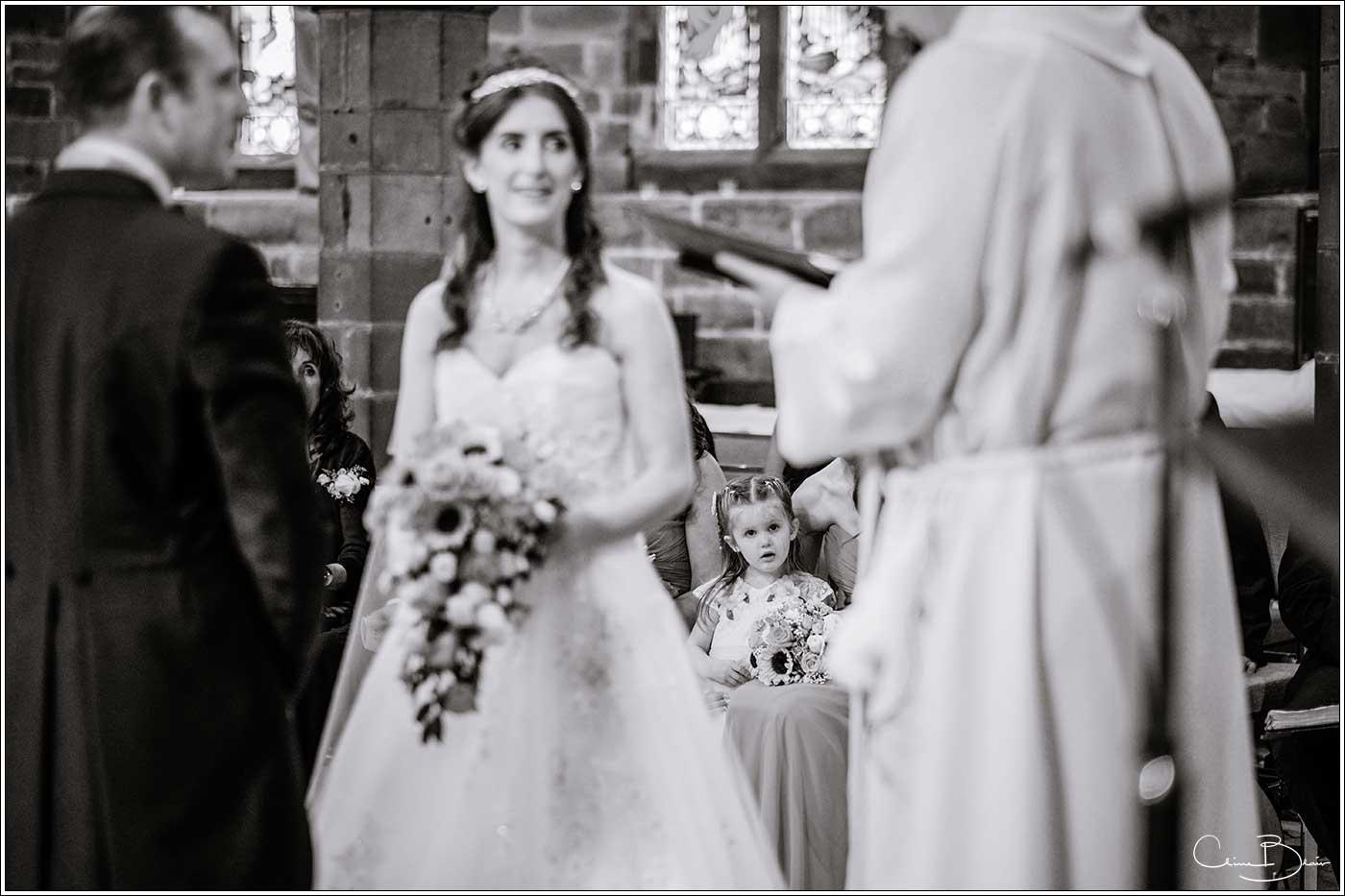 Flowergirl watching ceremony: Bank House Wedding Photographer Clive Blair Photography. Documentary Birmingham Wedding Photographer