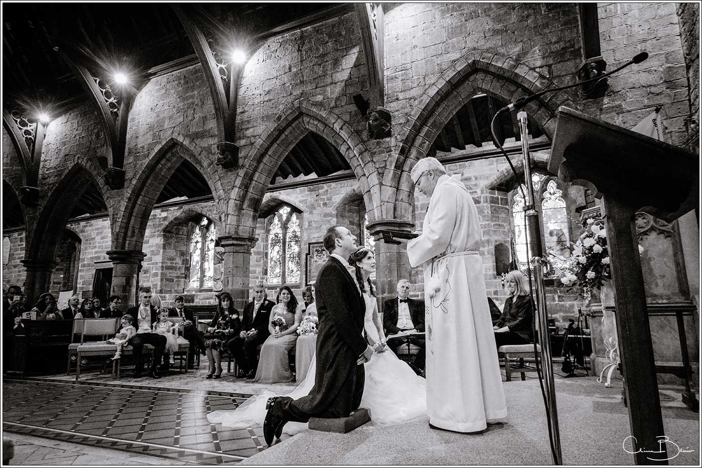 Bride and groom al alter: Bank House Wedding Photographer Clive Blair Photography. Documentary Birmingham Wedding Photographer
