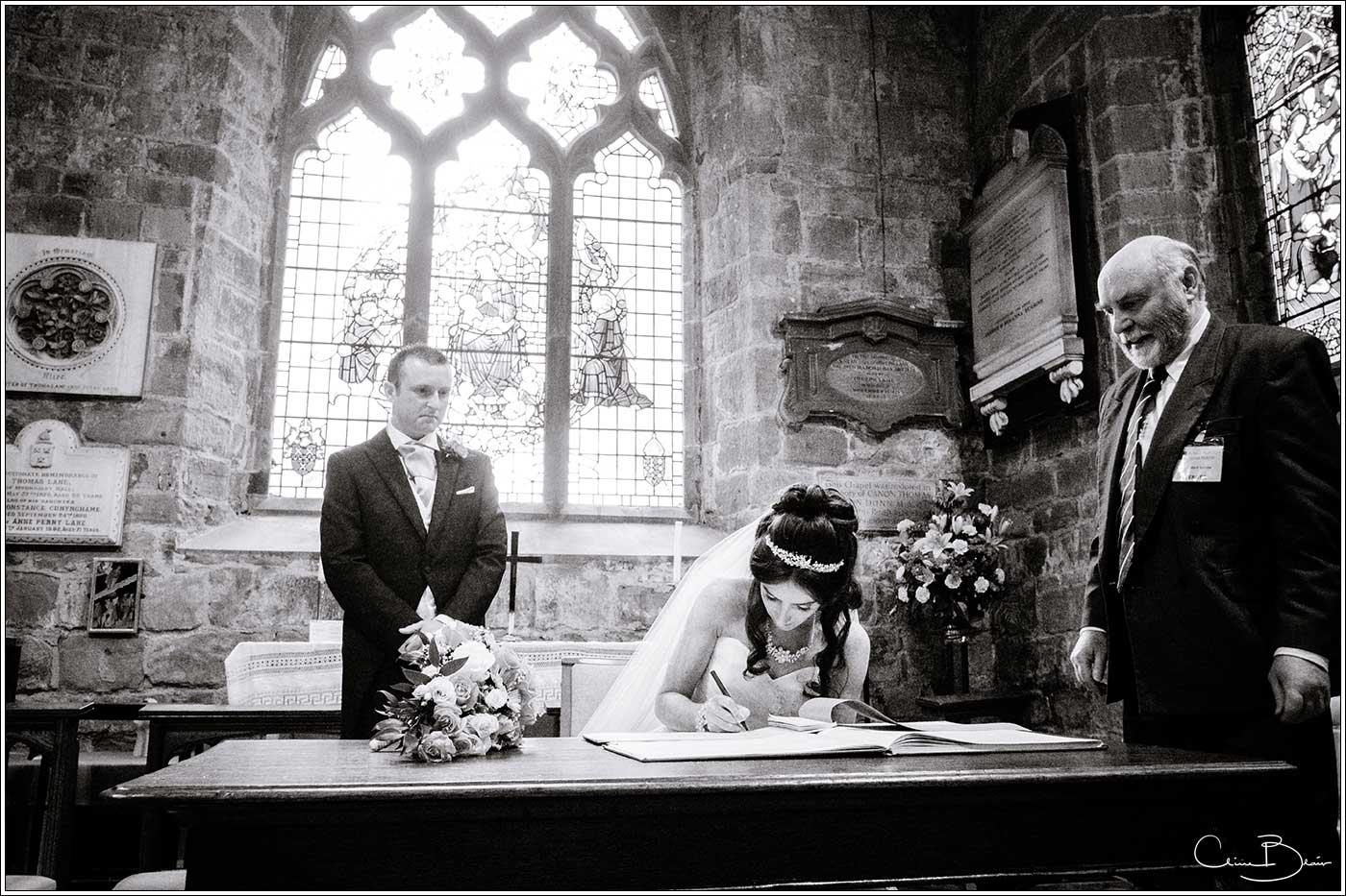 Bride signing register: Bank House Wedding Photographer Clive Blair Photography. Documentary Birmingham Wedding Photographer