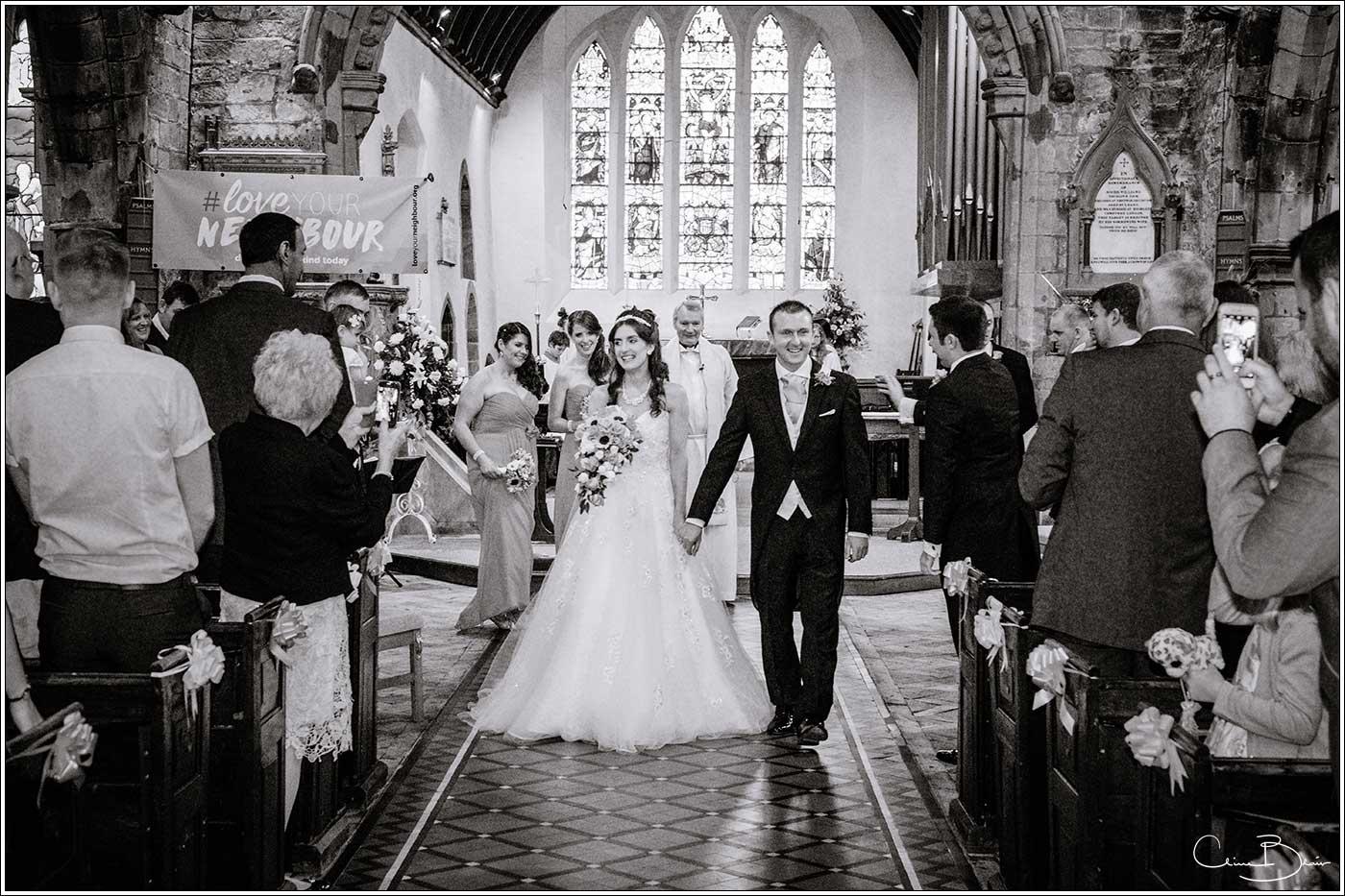 Bride and walking walking down aisle: Bank House Wedding Photographer Clive Blair Photography. Documentary Birmingham Wedding Photographer